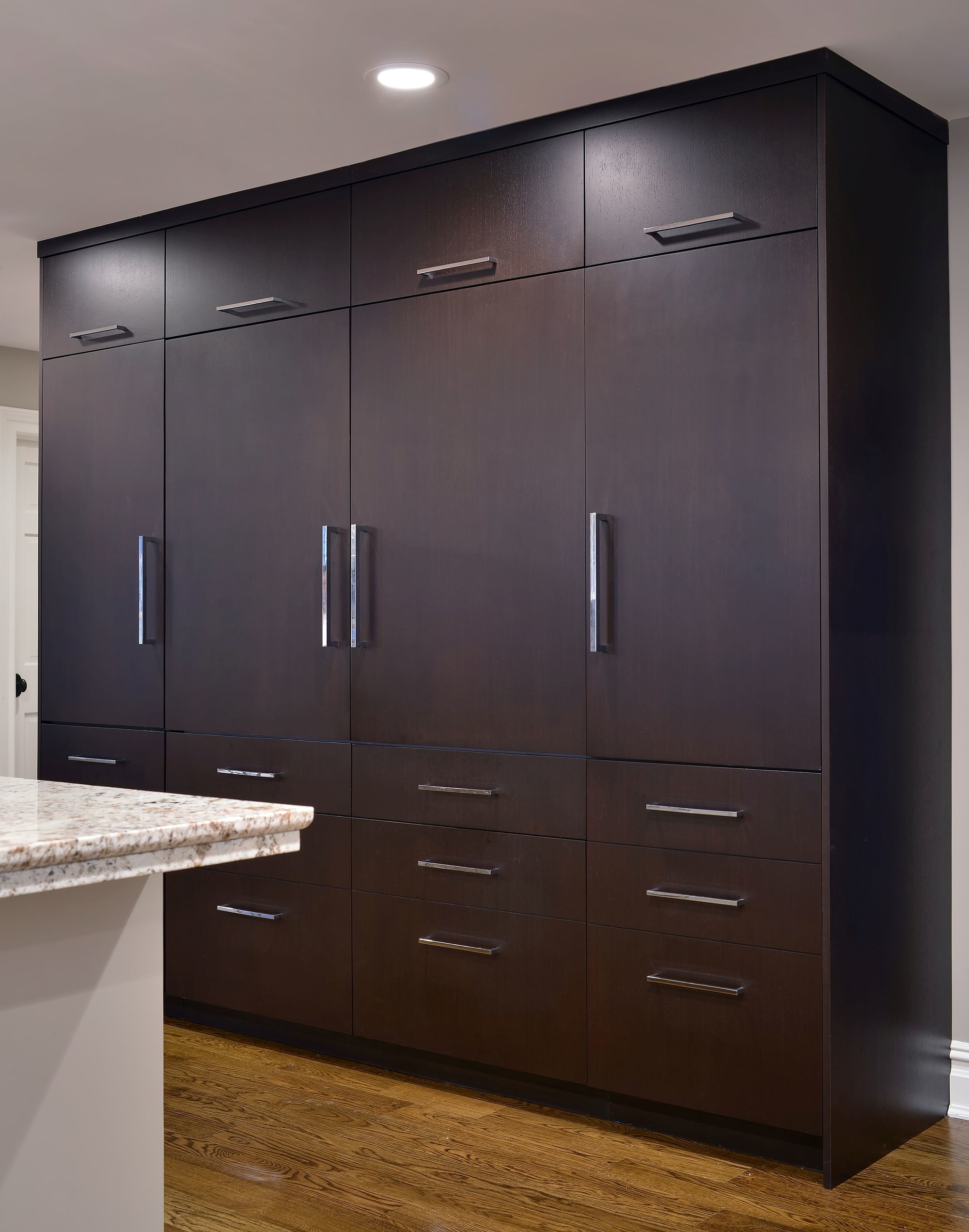 Transitional style kitchen with large wooden cabinet