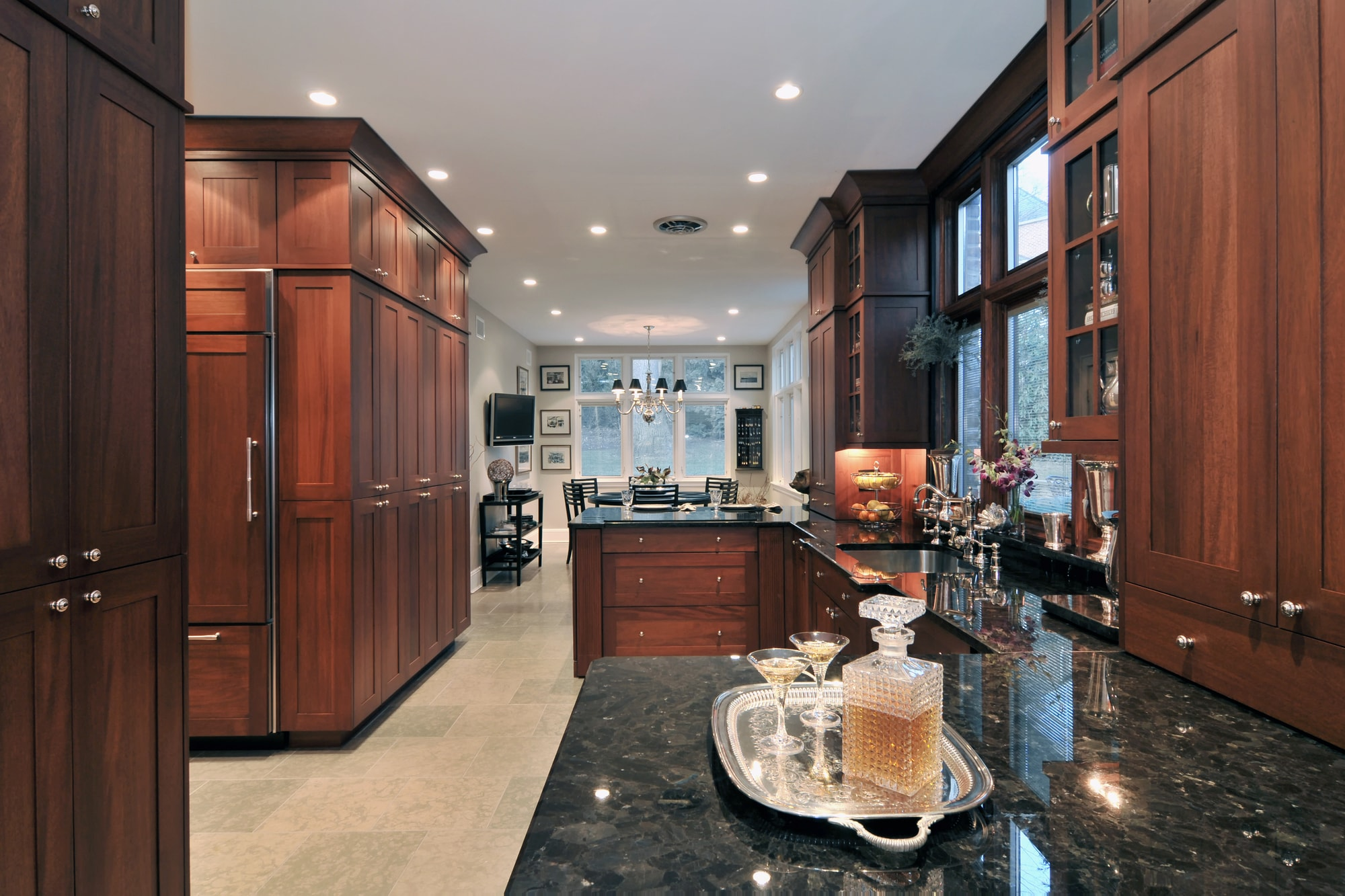 Transitional style kitchen with large cabinets