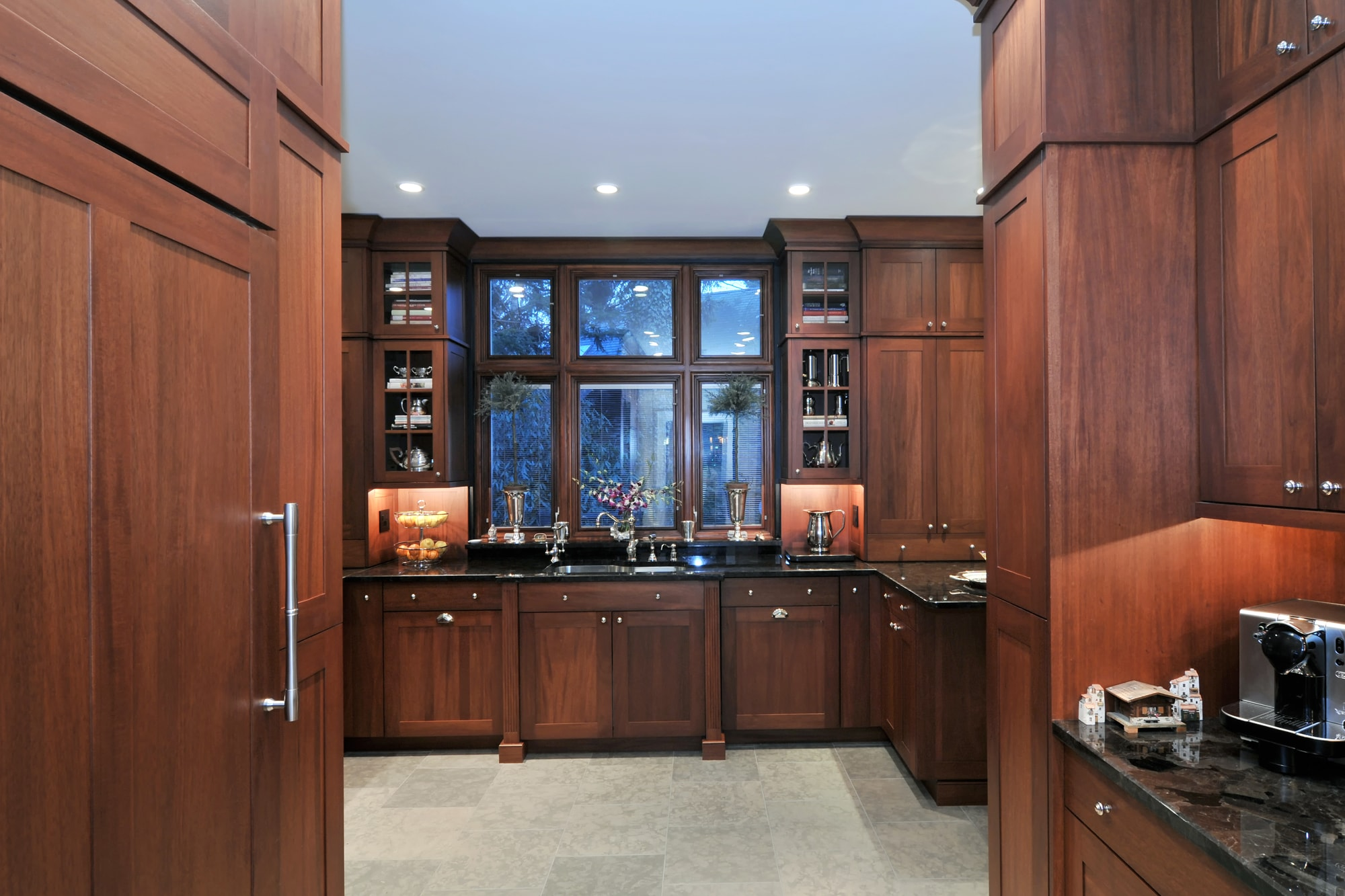 Transitional style kitchen with wooden storage