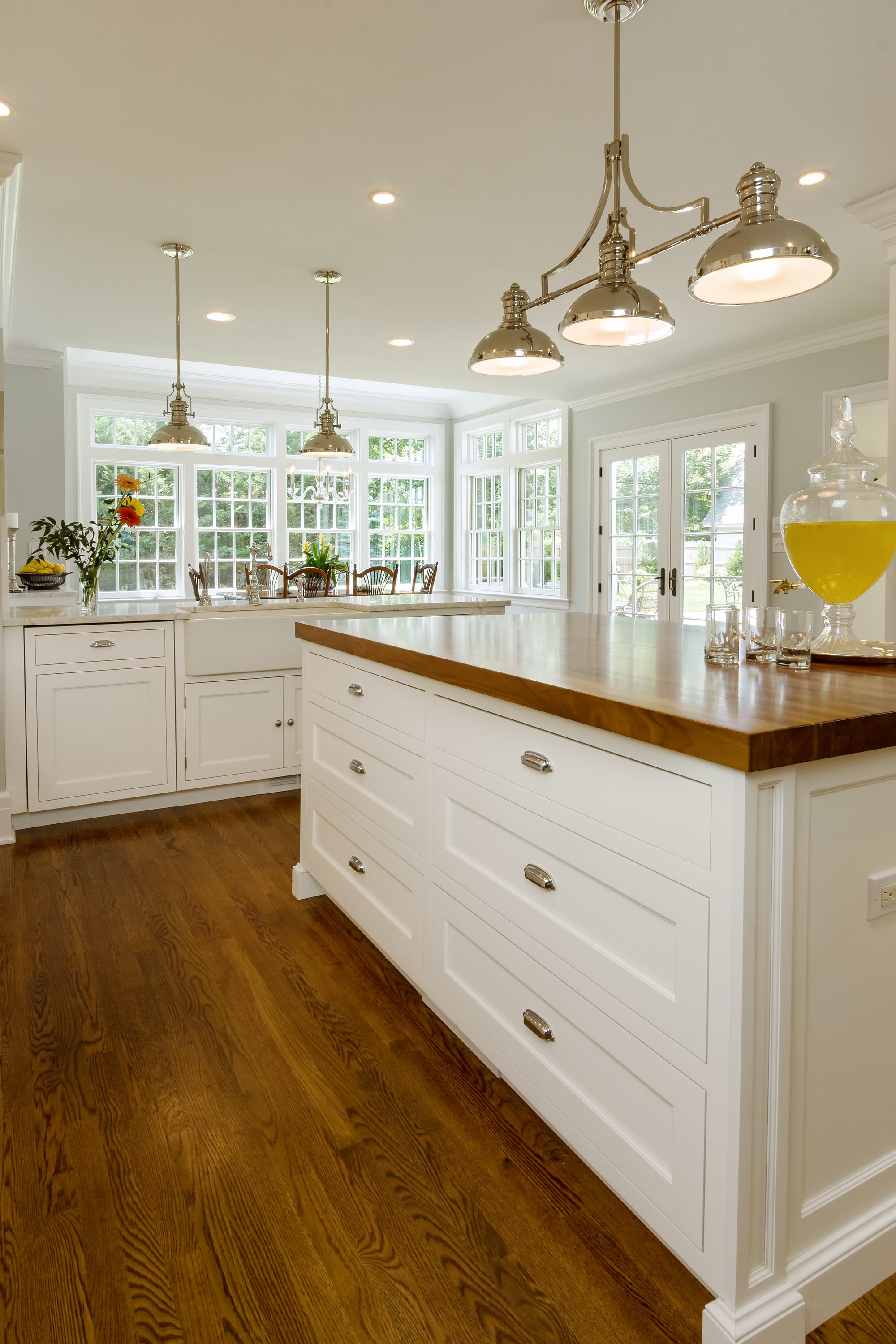 Transitional style kitchen with three light chandelier
