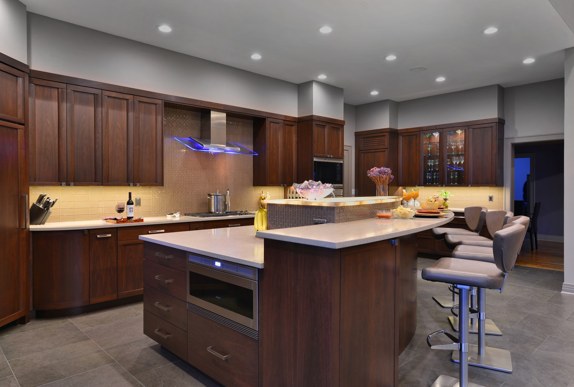 Transitional style kitchen with counter stools