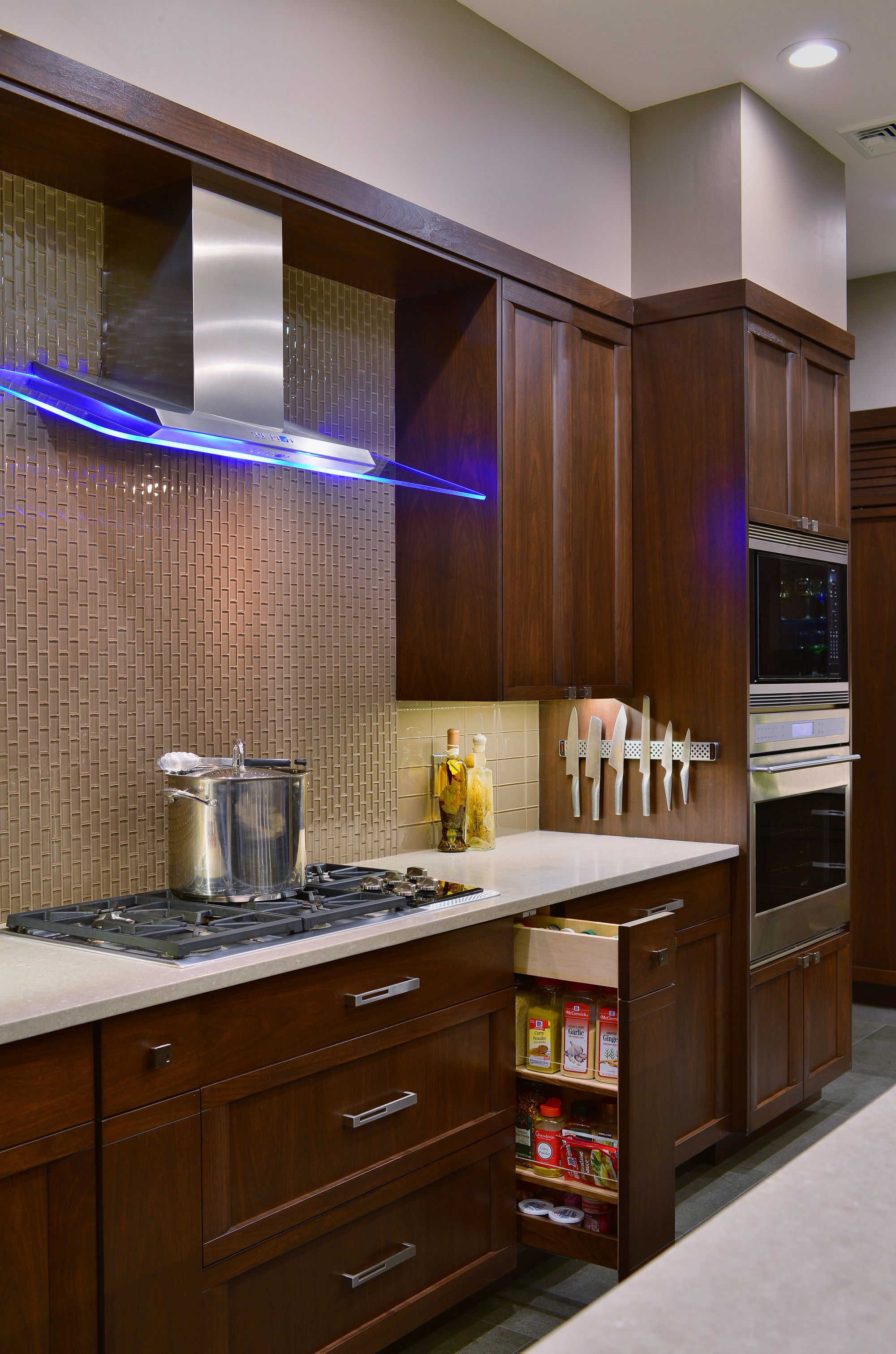 Transitional style kitchen with space saving drawer