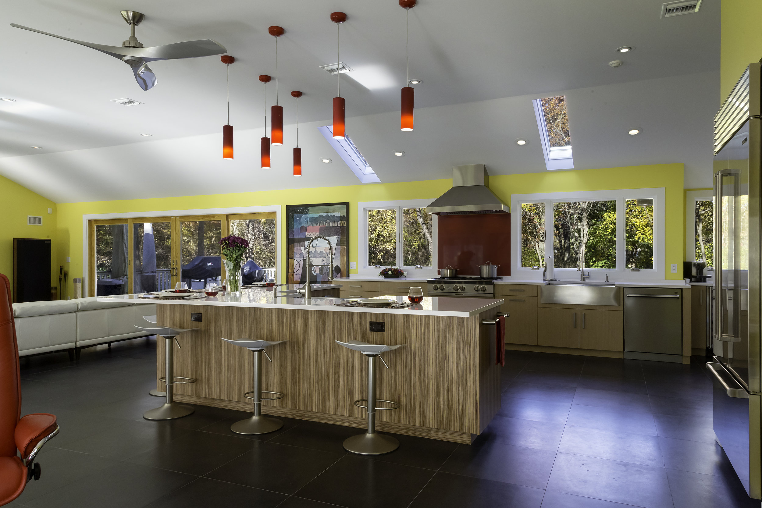 Contemporary style kitchen with three counter stools
