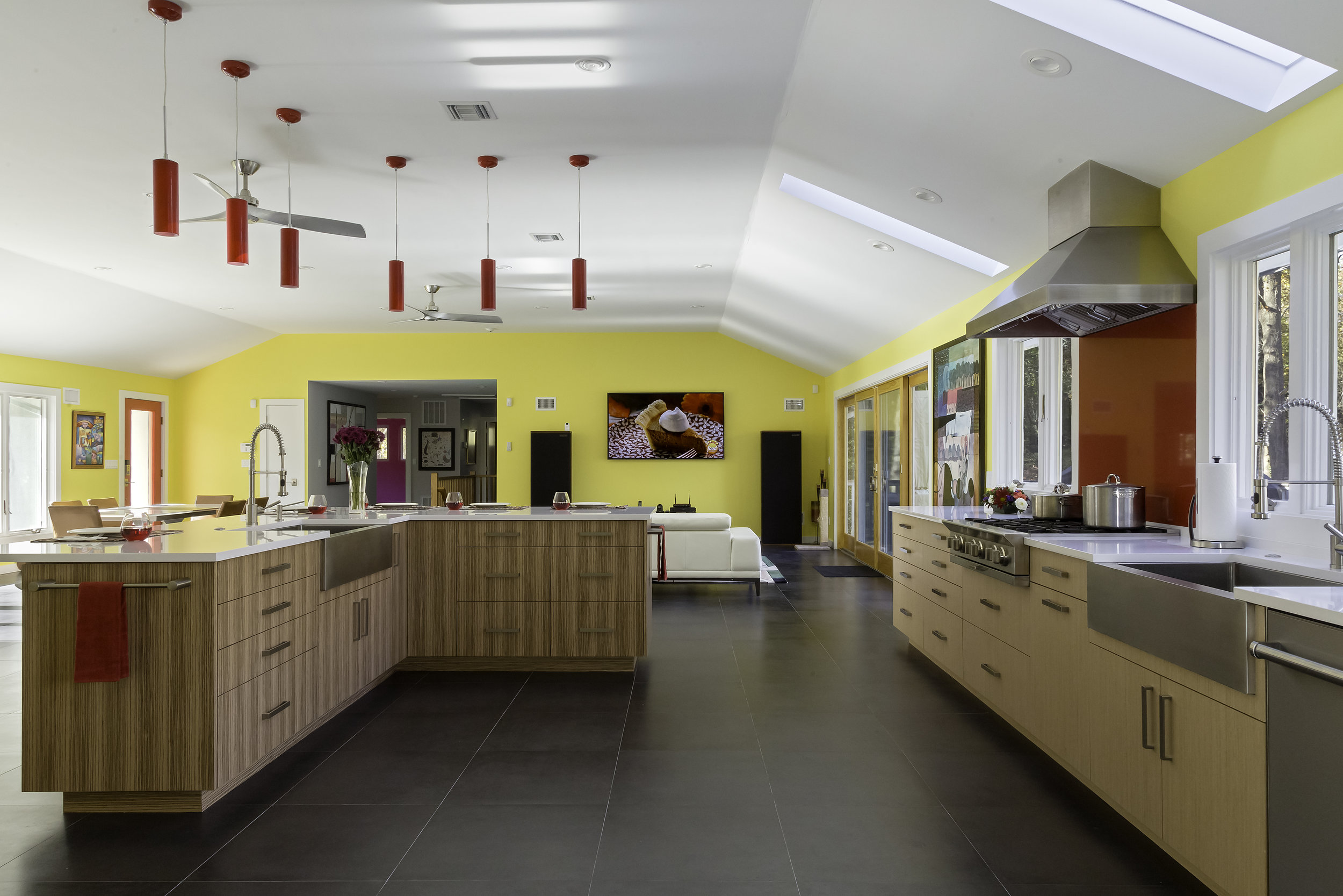 Contemporary style kitchen with six pendant light fixtures