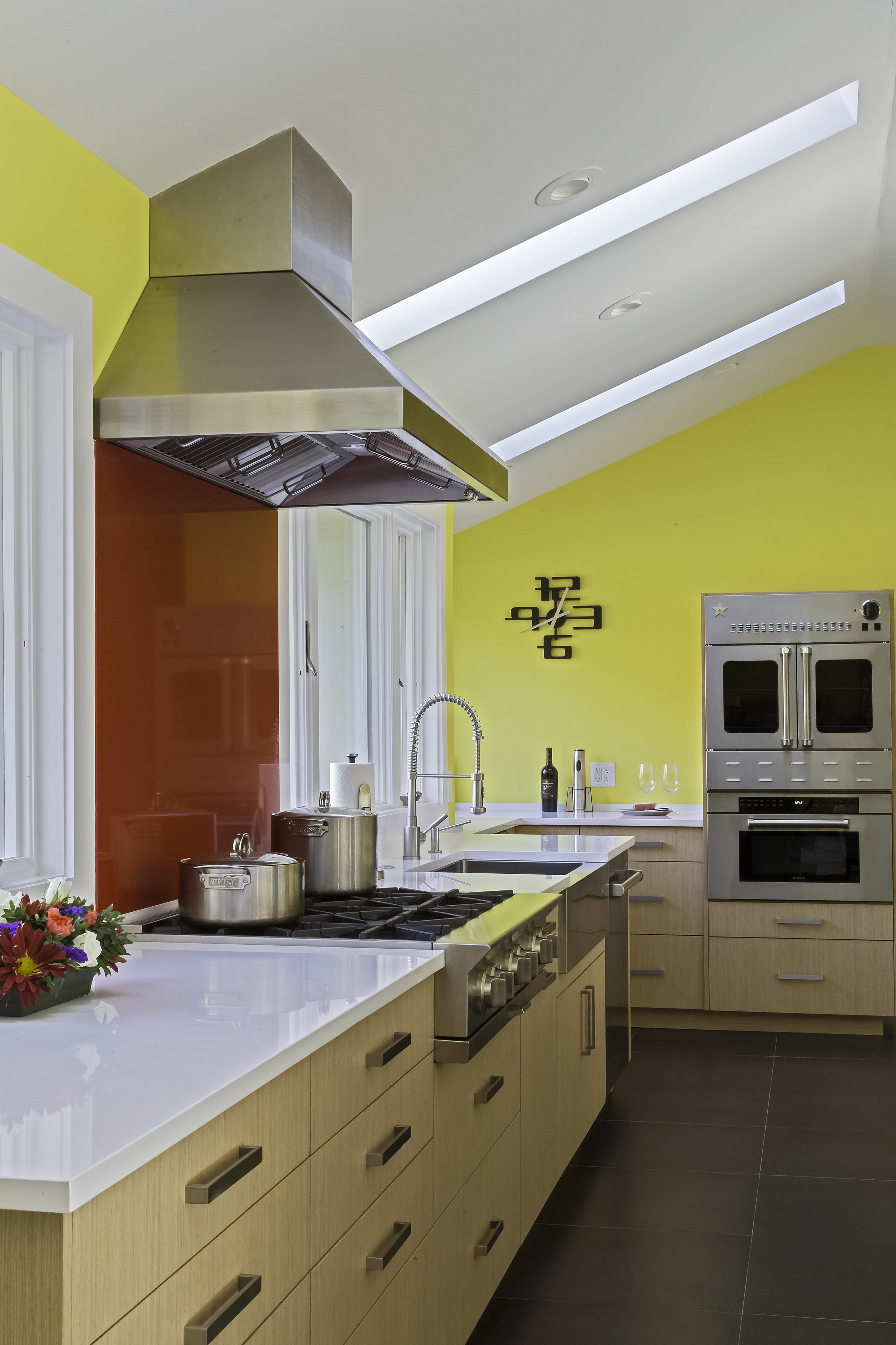 Contemporary style kitchen with range and rangehood