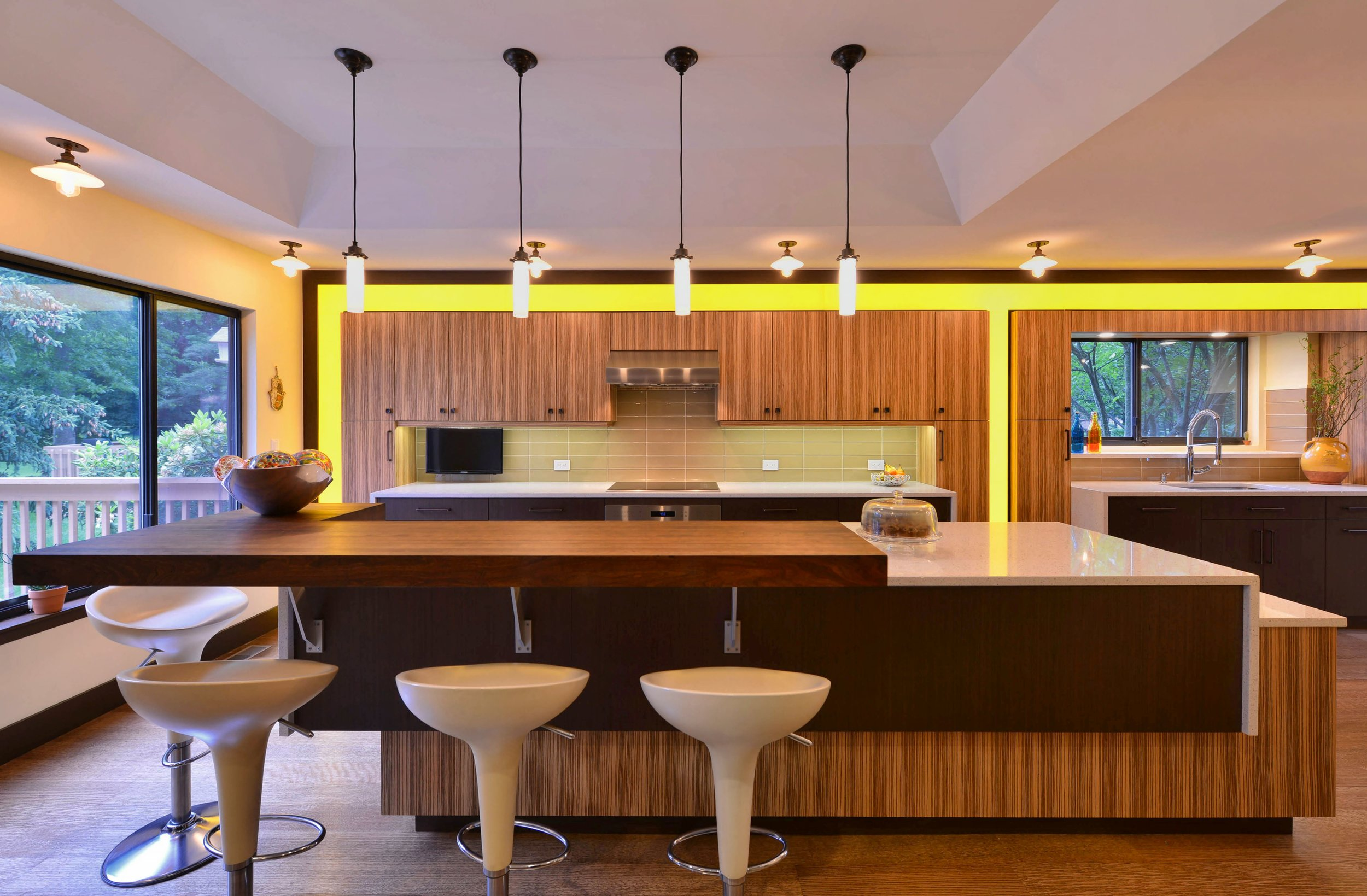 Contemporary style kitchen with multi level center island