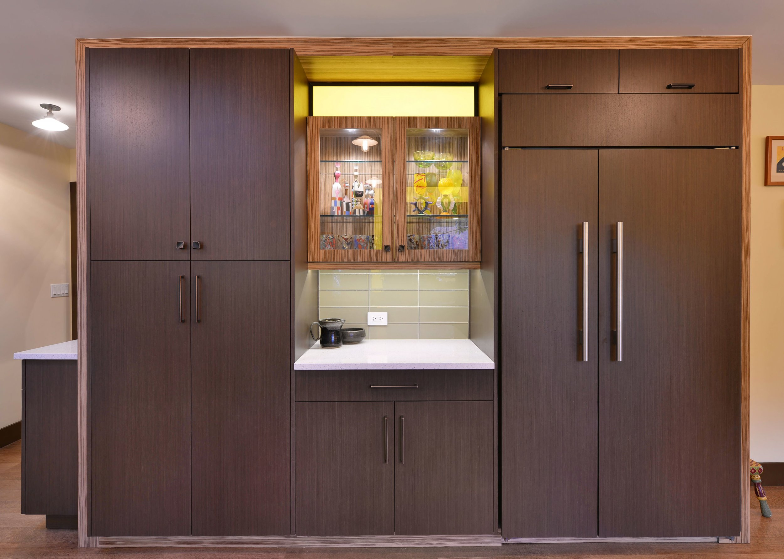 Contemporary style kitchen with wooden cabinets and glass door upper cabinet