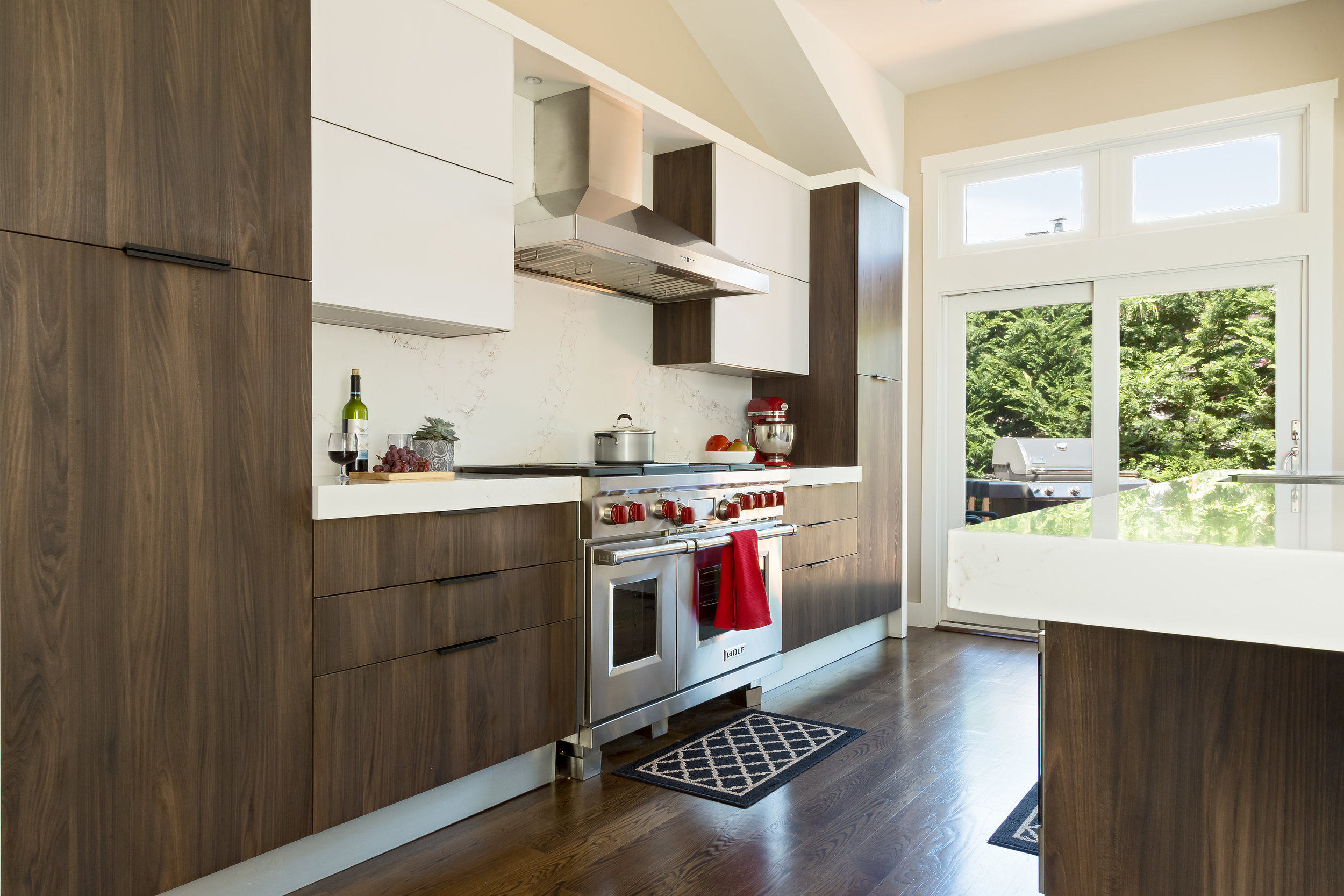 Contemporary style kitchen with wooden pull out drawers
