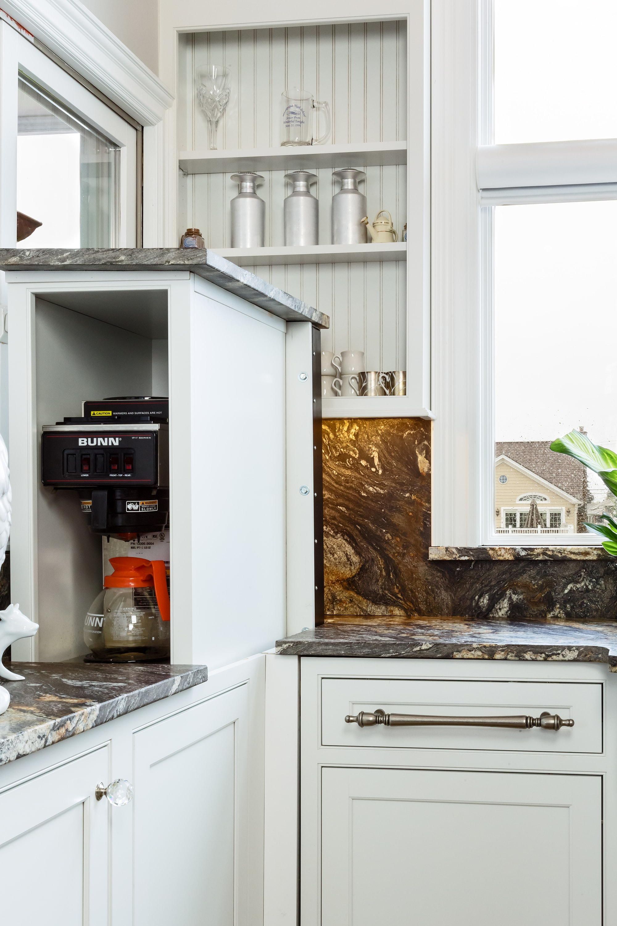 Traditional style kitchen with custom built coffee maker storage