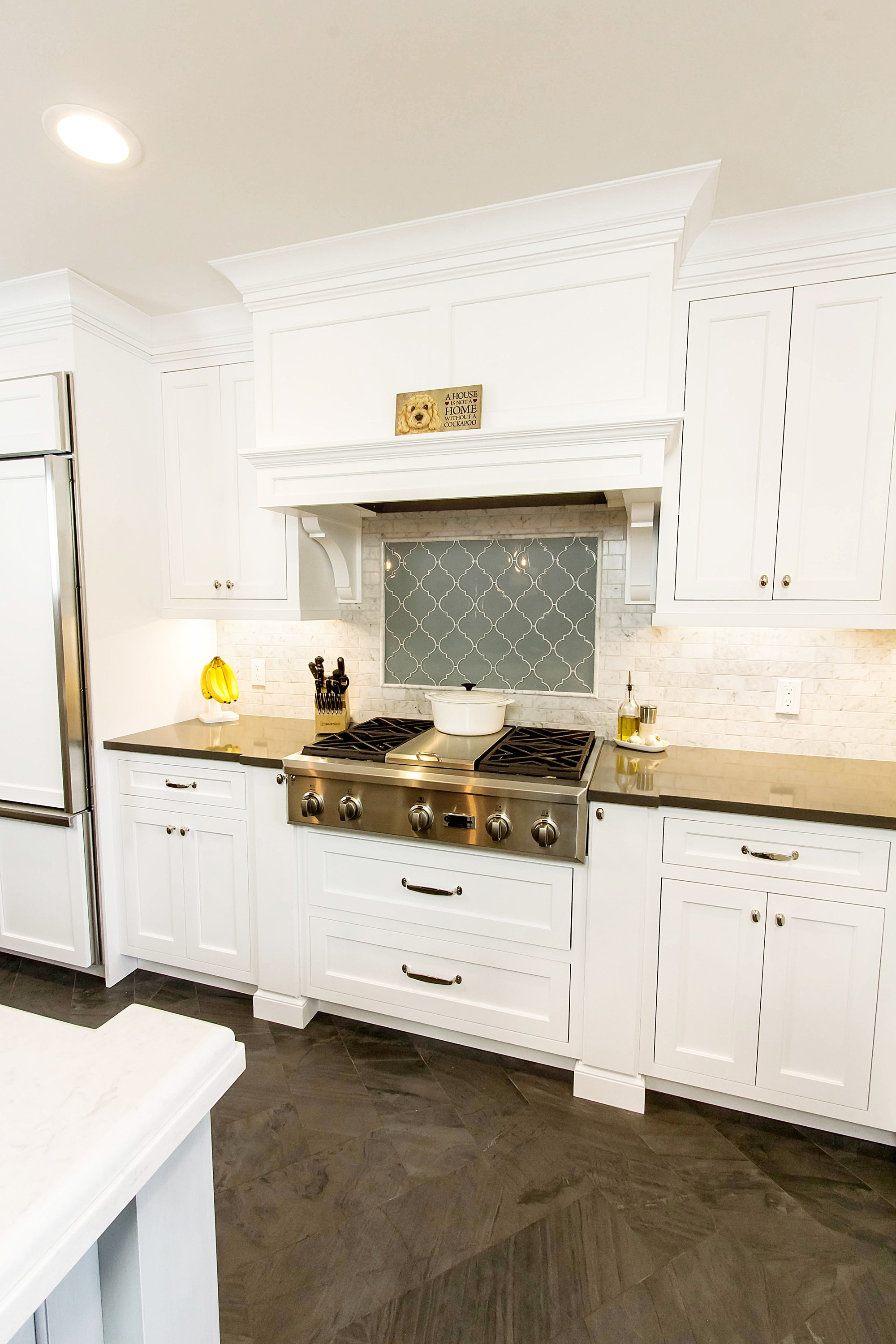 Traditional style kitchen with stainless range