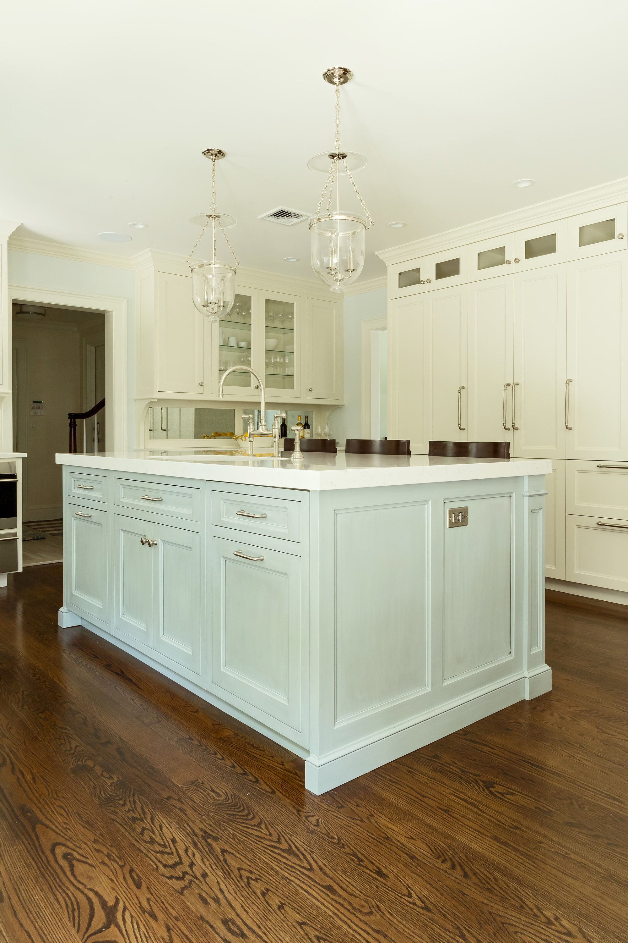 Transitional style kitchen with two hanging pendant light fixture
