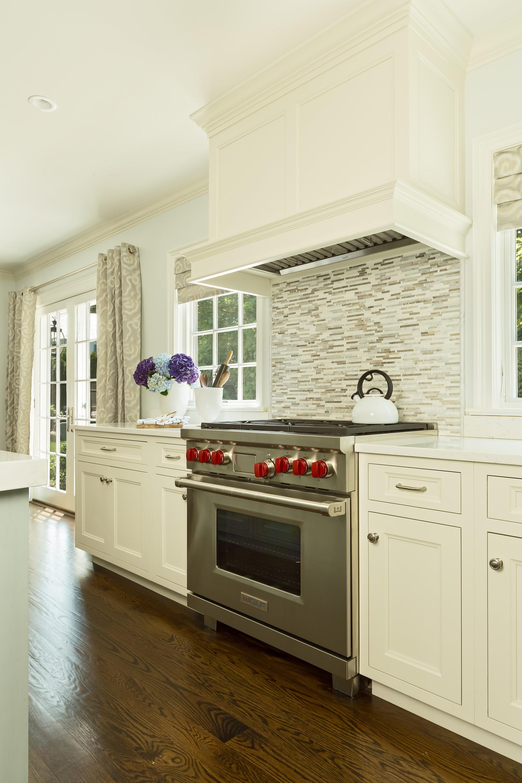Transitional style kitchen with simple tile backsplash