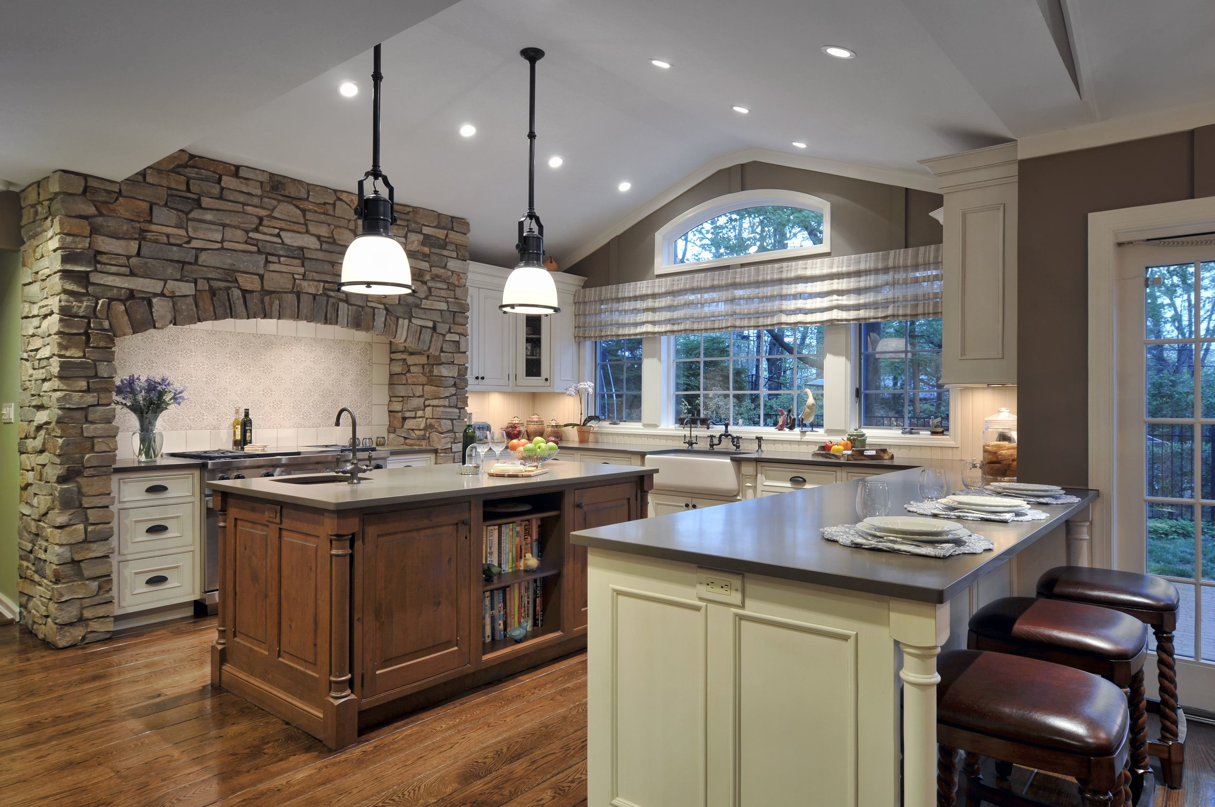 Traditional style kitchen with warm tones and marble kitchen island