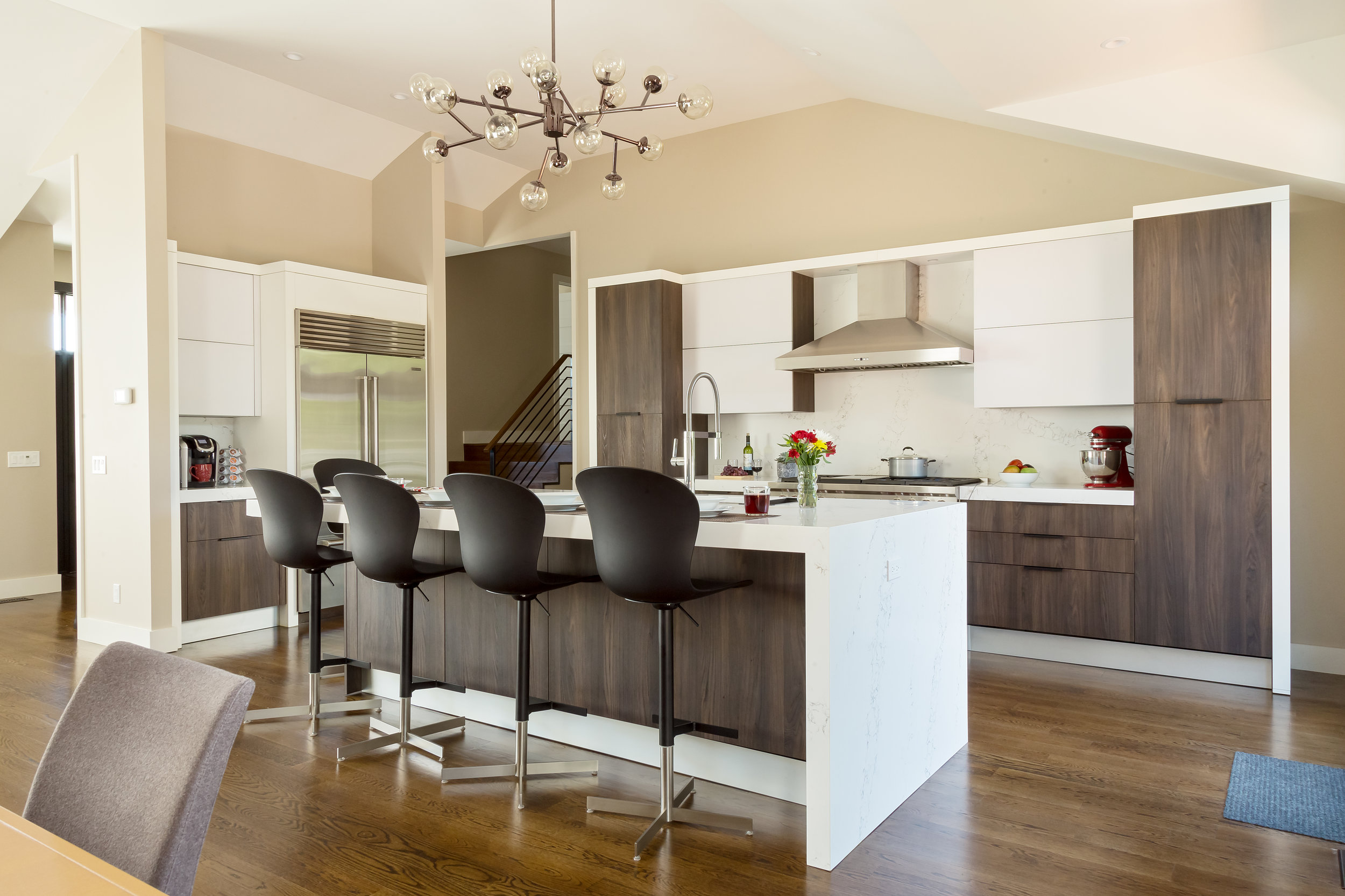 Contemporary style kitchen with blue kitchen island