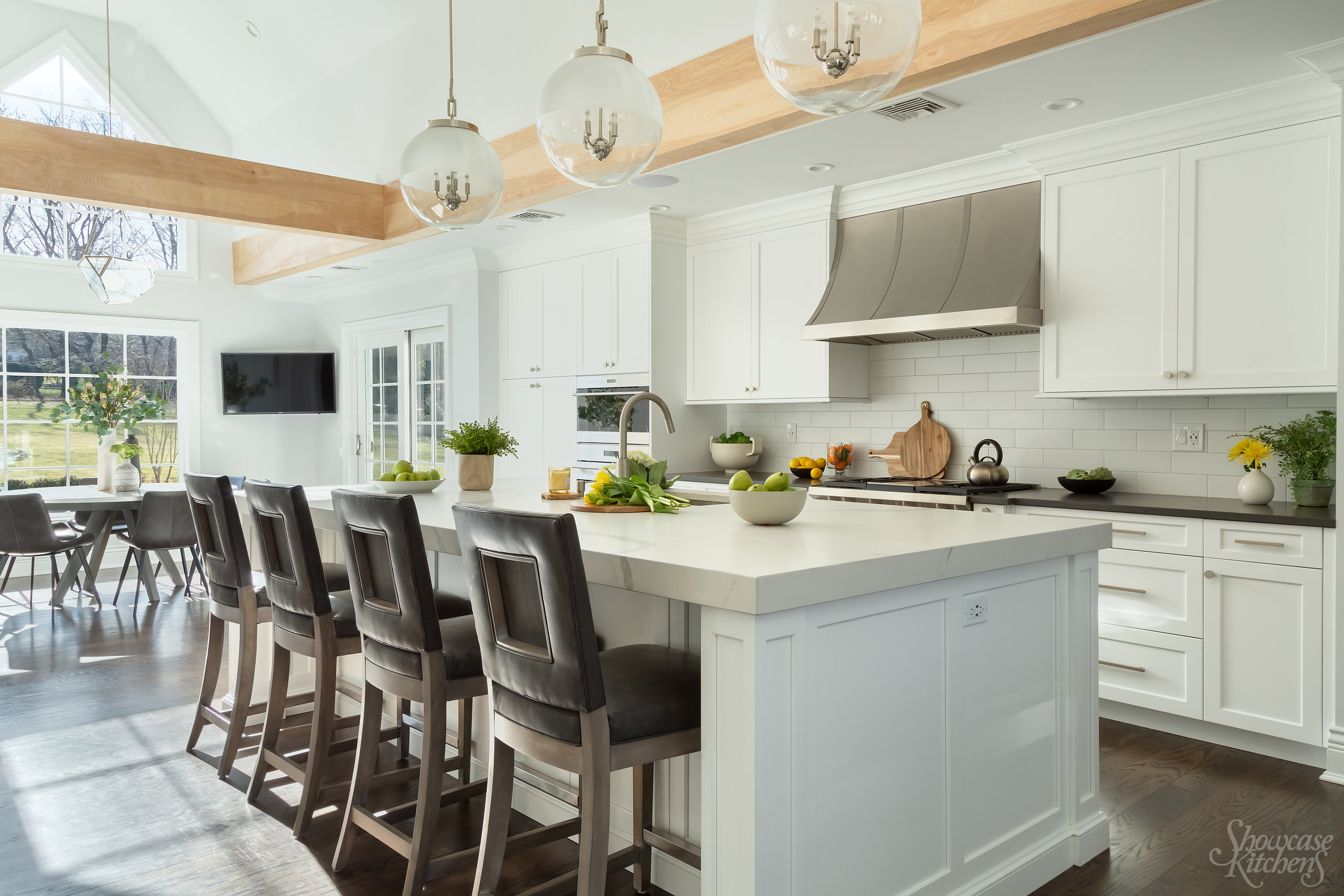 "Transitional style kitchen with beam and 3"" quartz countertop"