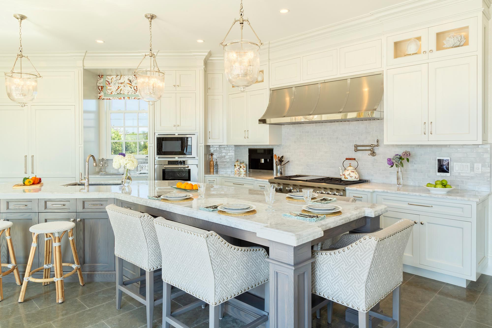 Transitional white kitchen with contemporary stools