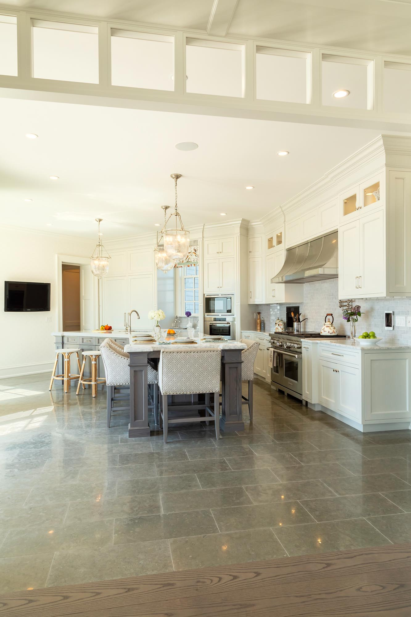 Transitional white kitchen with detailed millwork