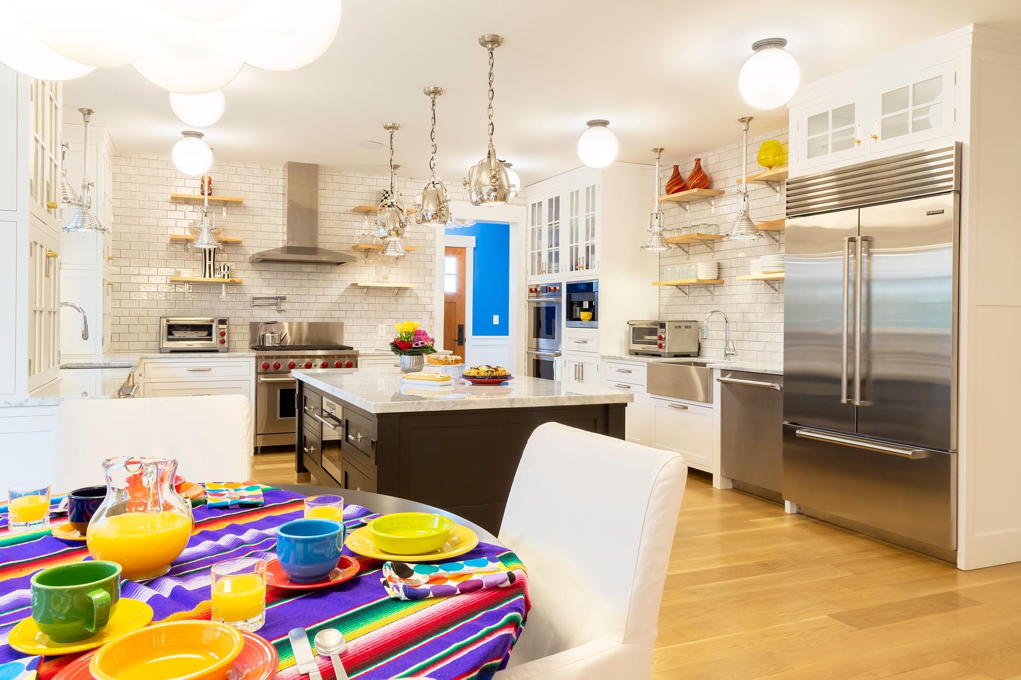 Transitional white kitchen with Sub Zero refrigerator freezer