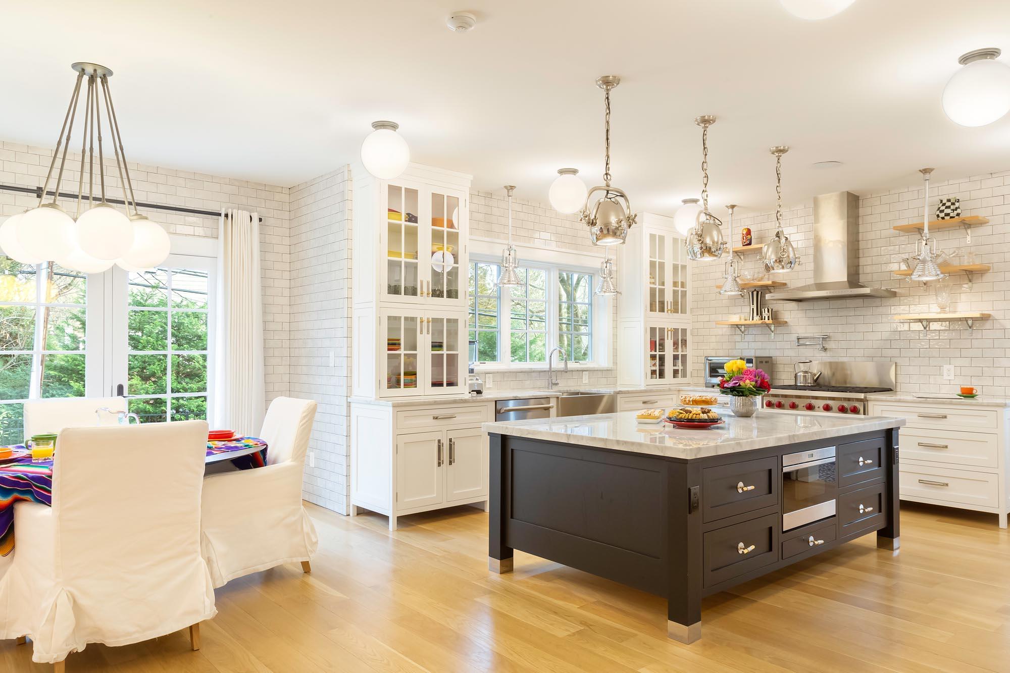 Transitional white kitchen with dark walnut center Island