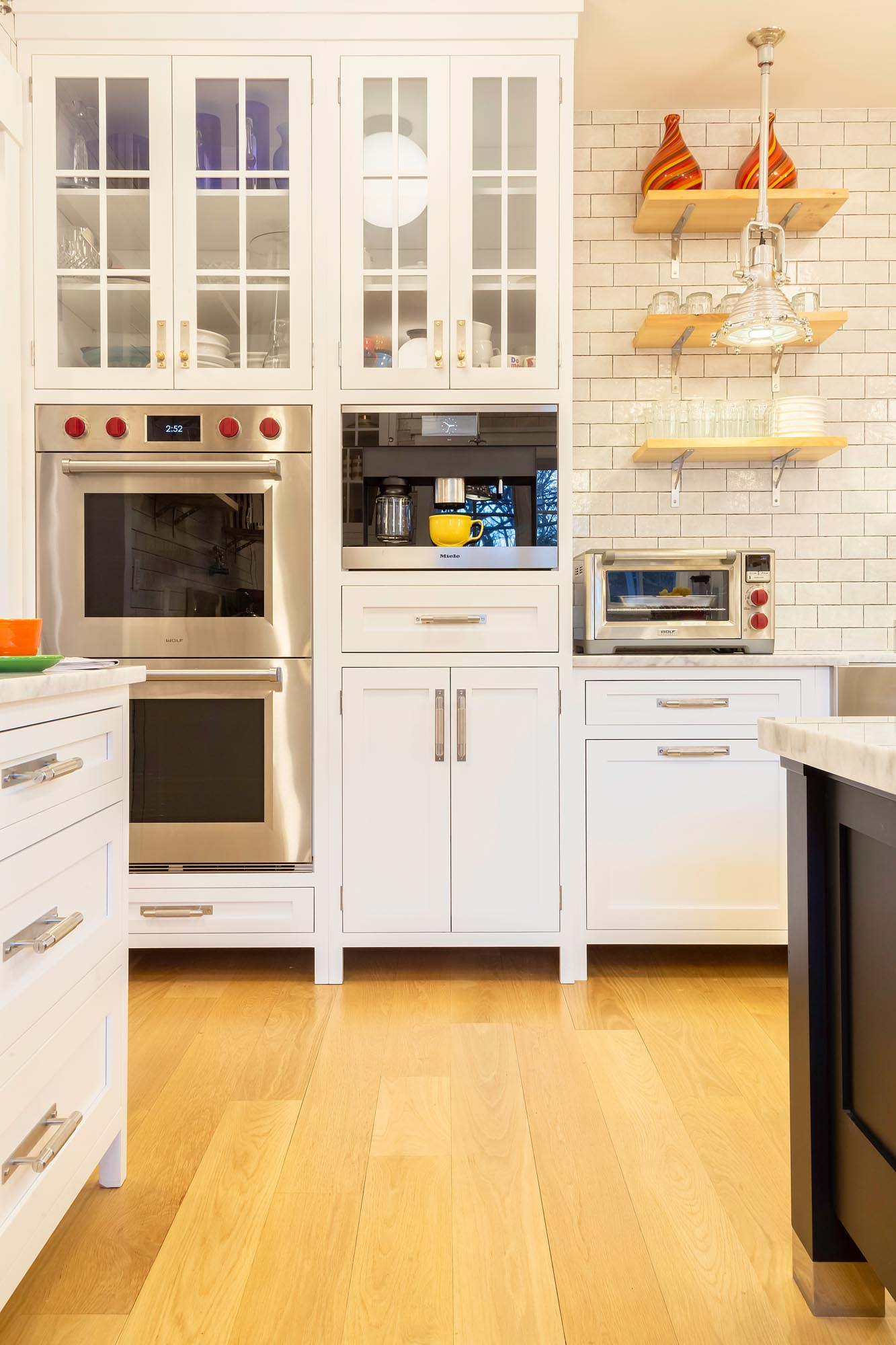 Transitional white kitchen with colorful highlights