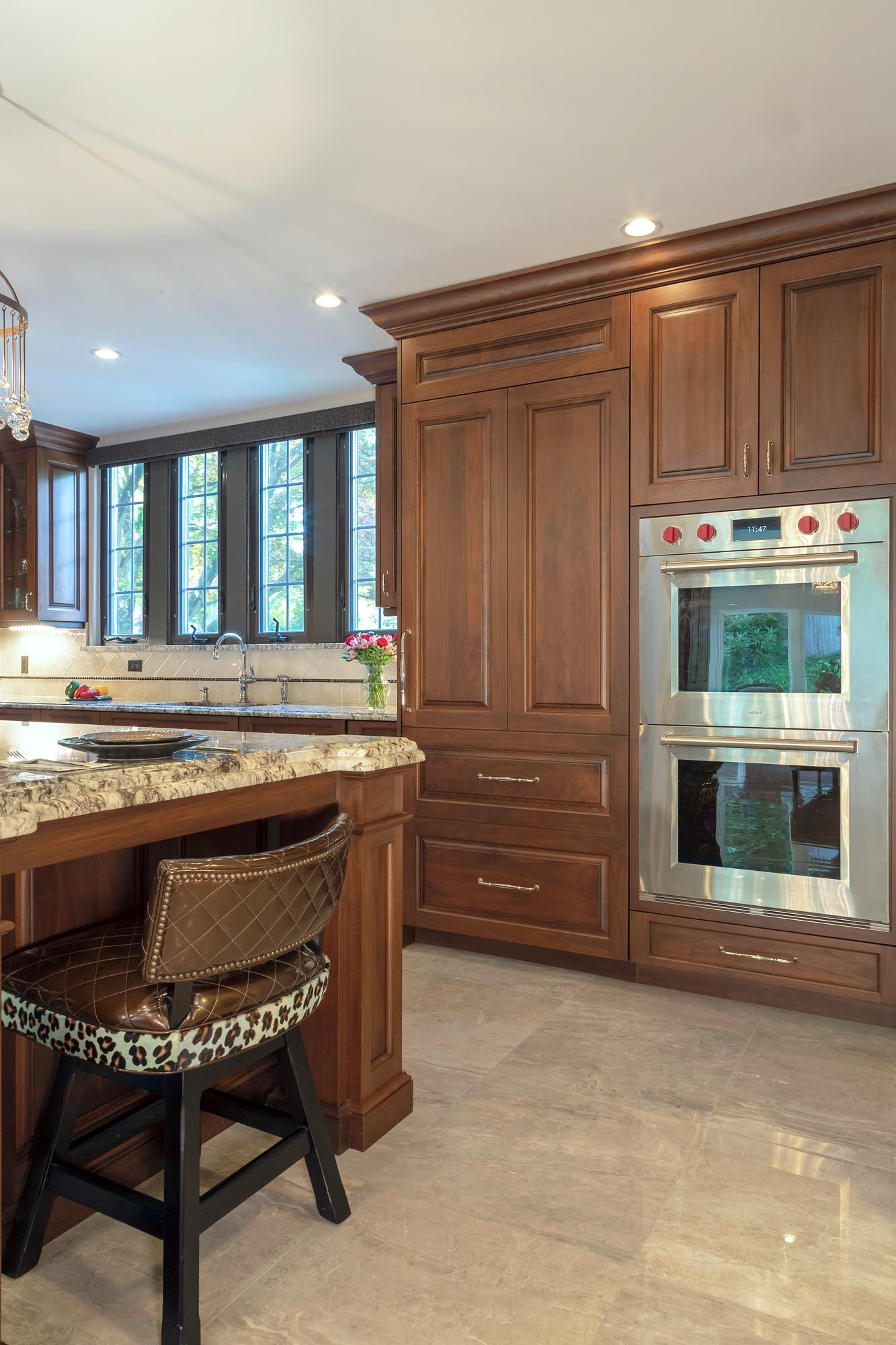 Traditional kitchen with double Wolf wall oven