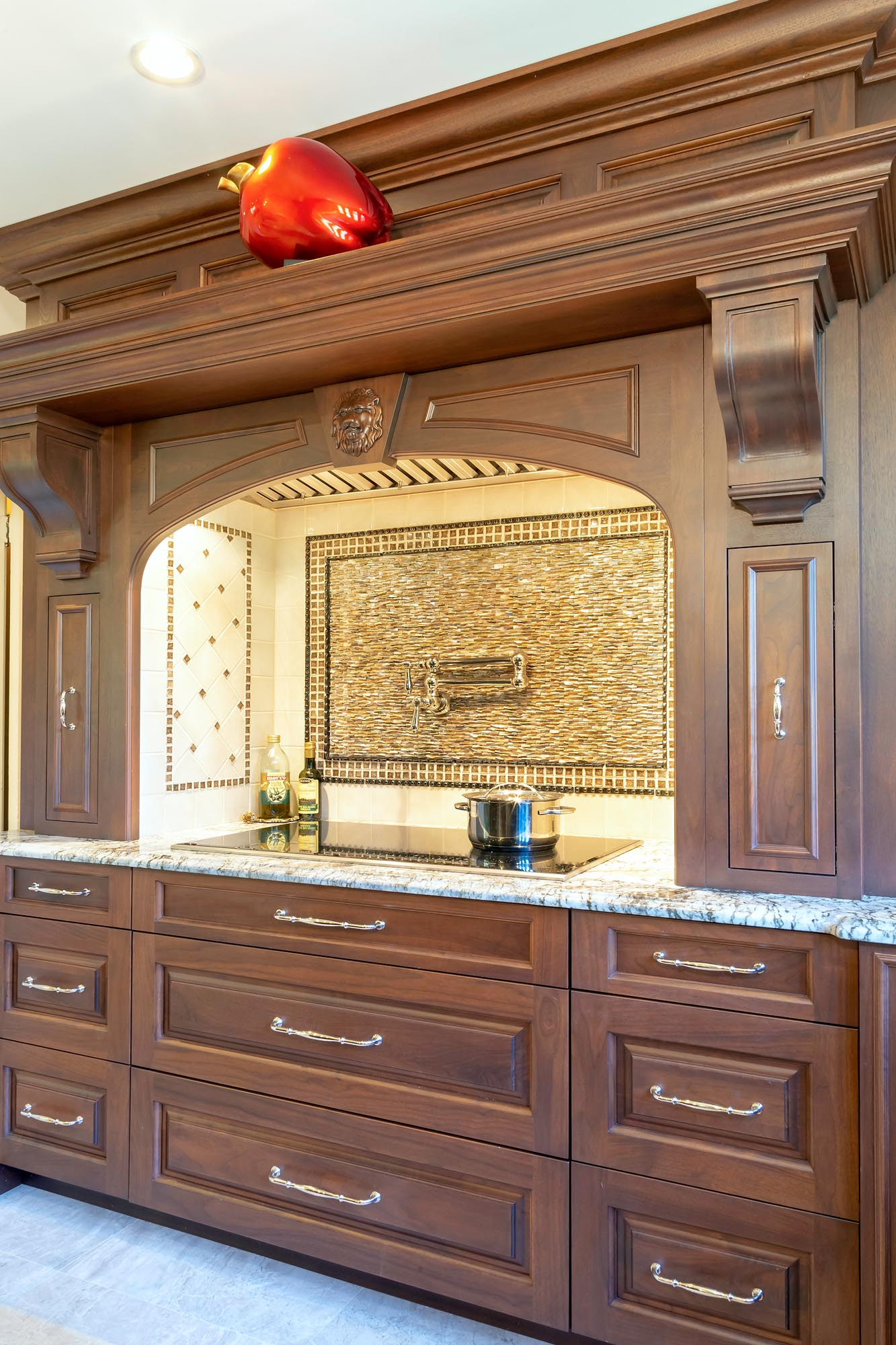 Custom alcove range hood with mantle and corbels
