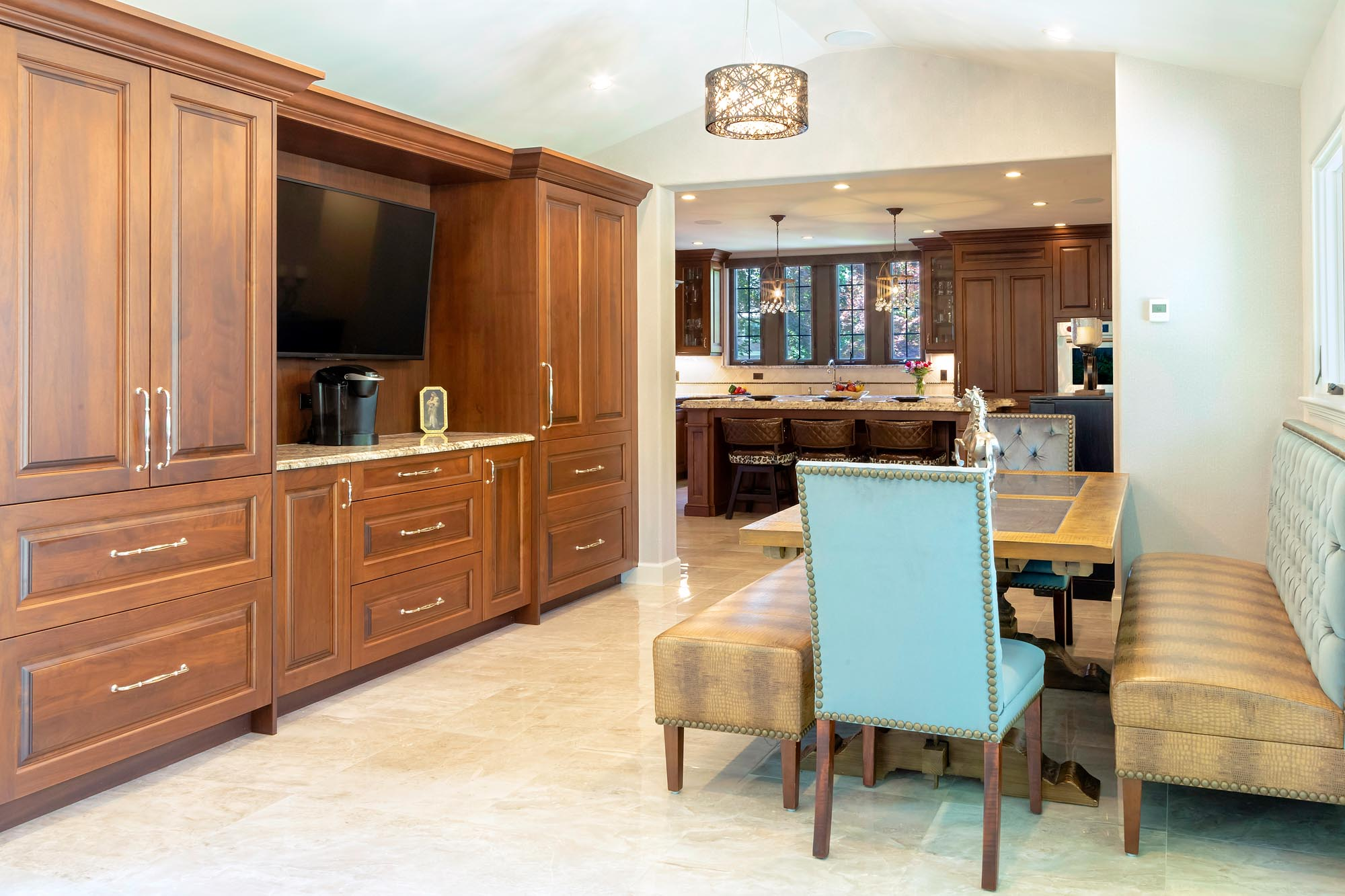 Walnut kitchen and adjoining breakfast area with contemporary nail head chair