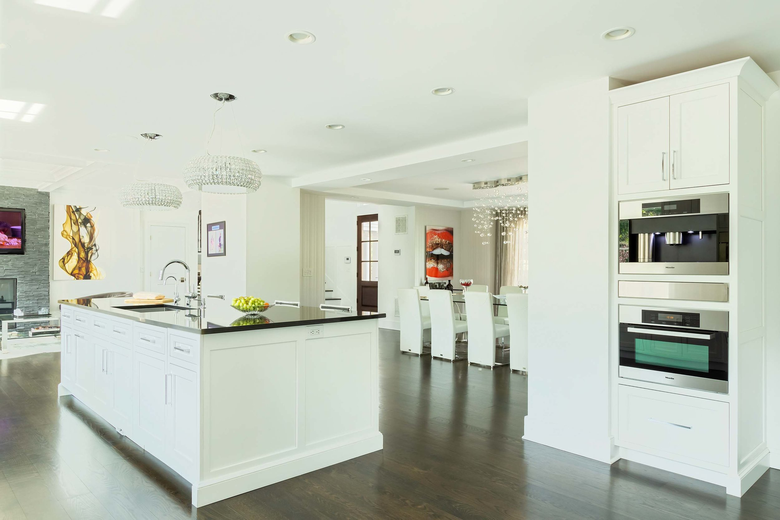 Transitional white kitchen with Wolf appliances