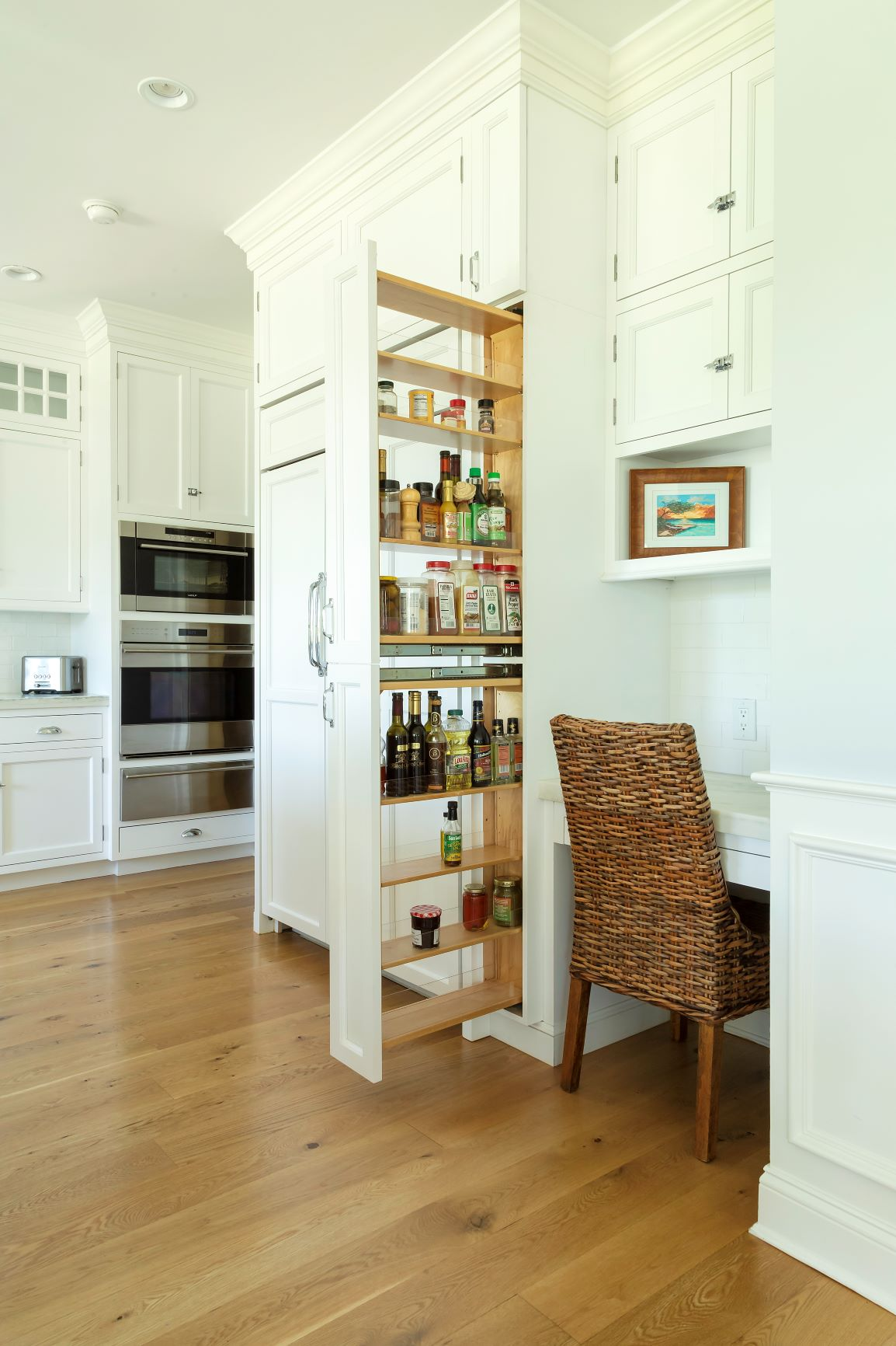 Transitional kitchen with desk area and pull out shelves
