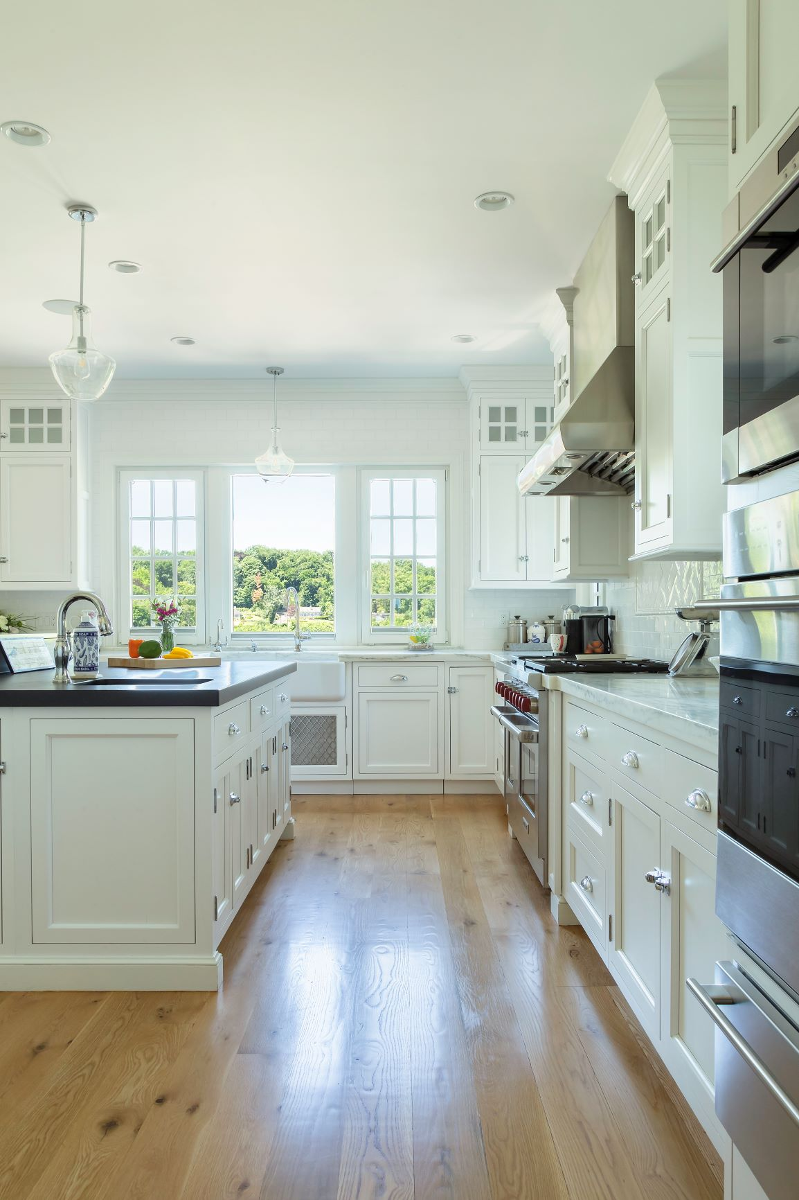Transitional kitchen with granite on custom center island