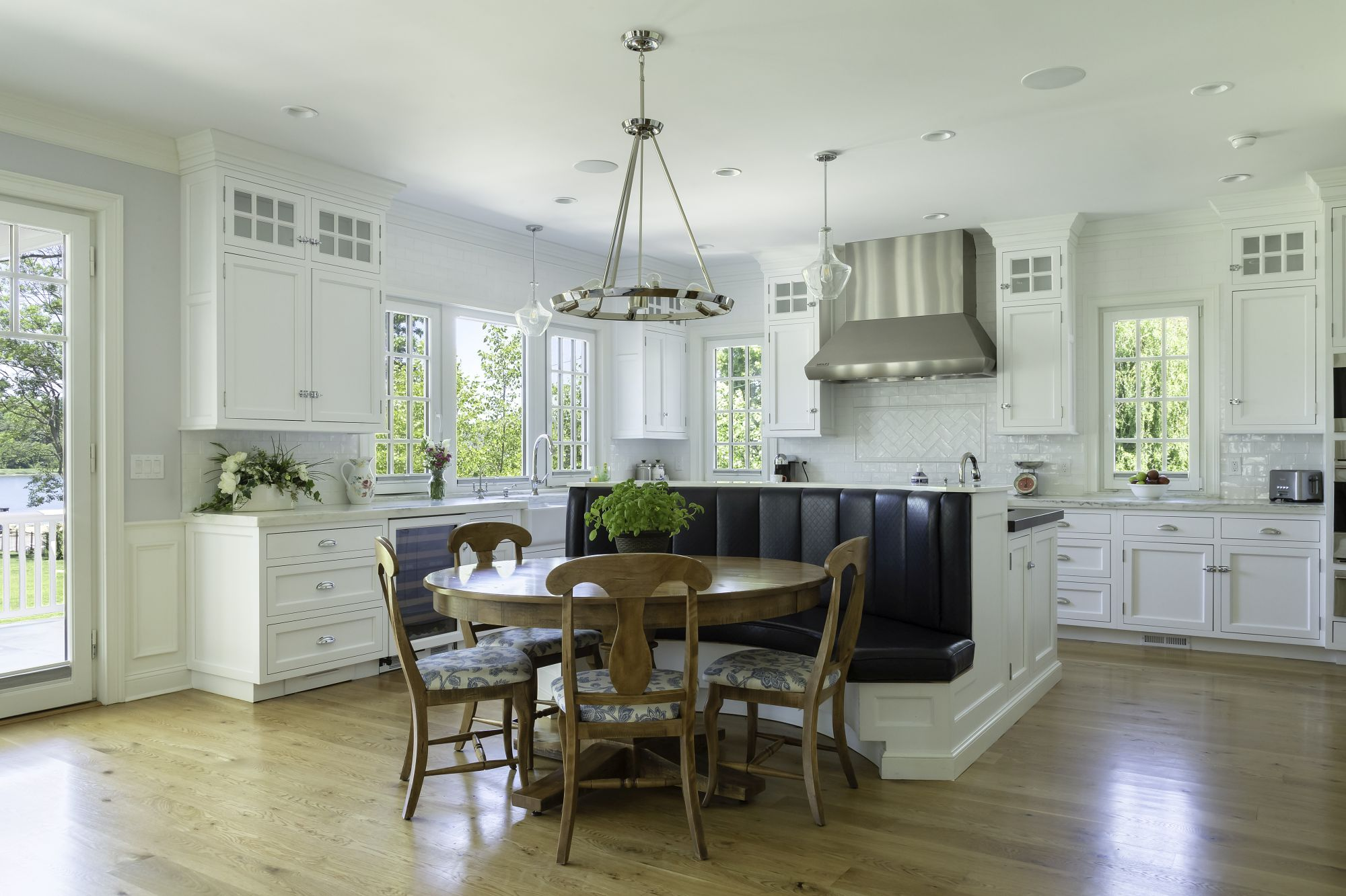 Transitional kitchen with large custom center island with banquette seating