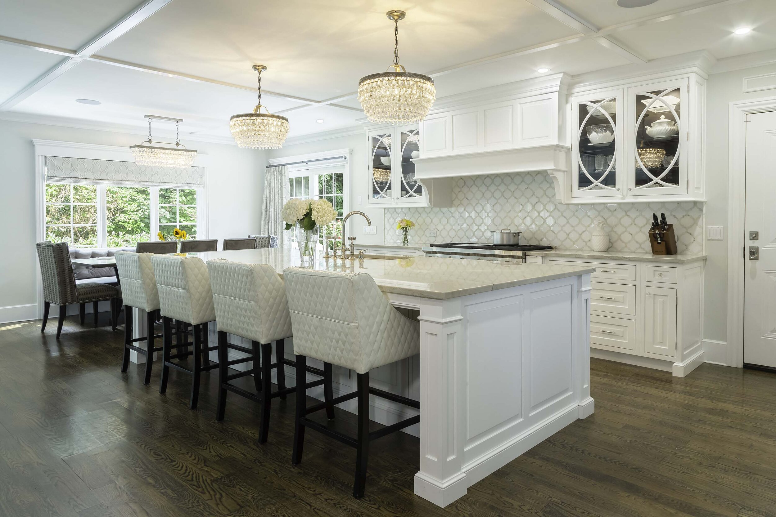 Traditional white kitchen on Long Island with oak floor