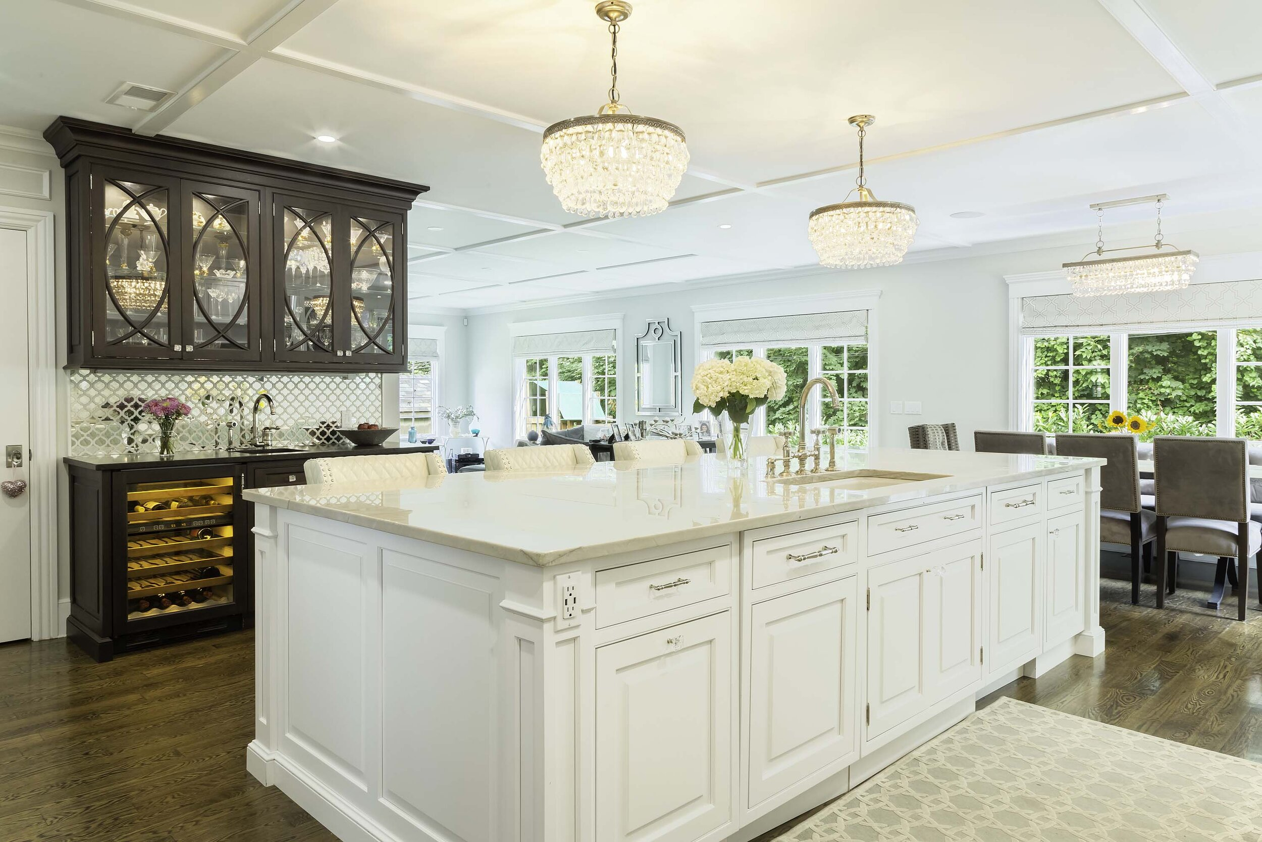 Traditional white kitchen on Long Island with mahogany butler and Sub Zero wine cooler