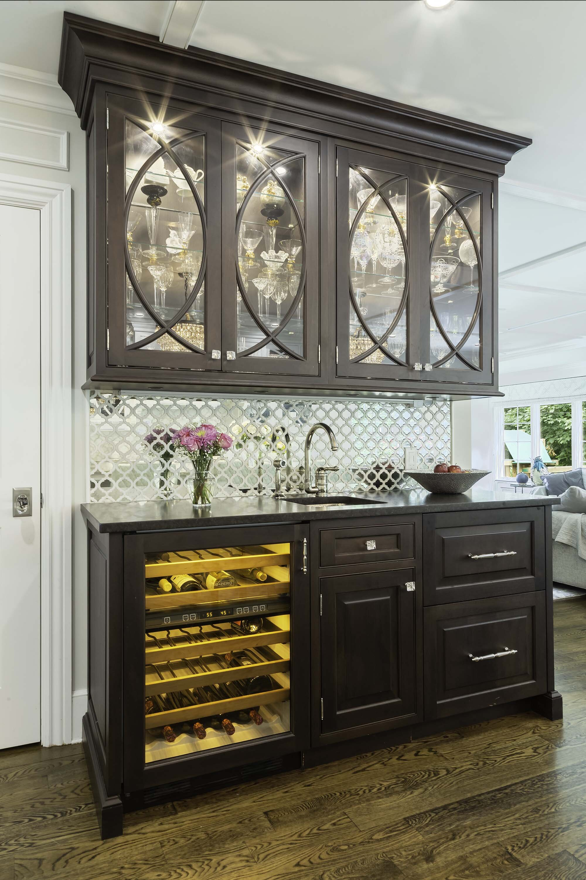 Traditional white kitchen with mahogany butler and Sub Zero wine cooler and mirror tile backsplash