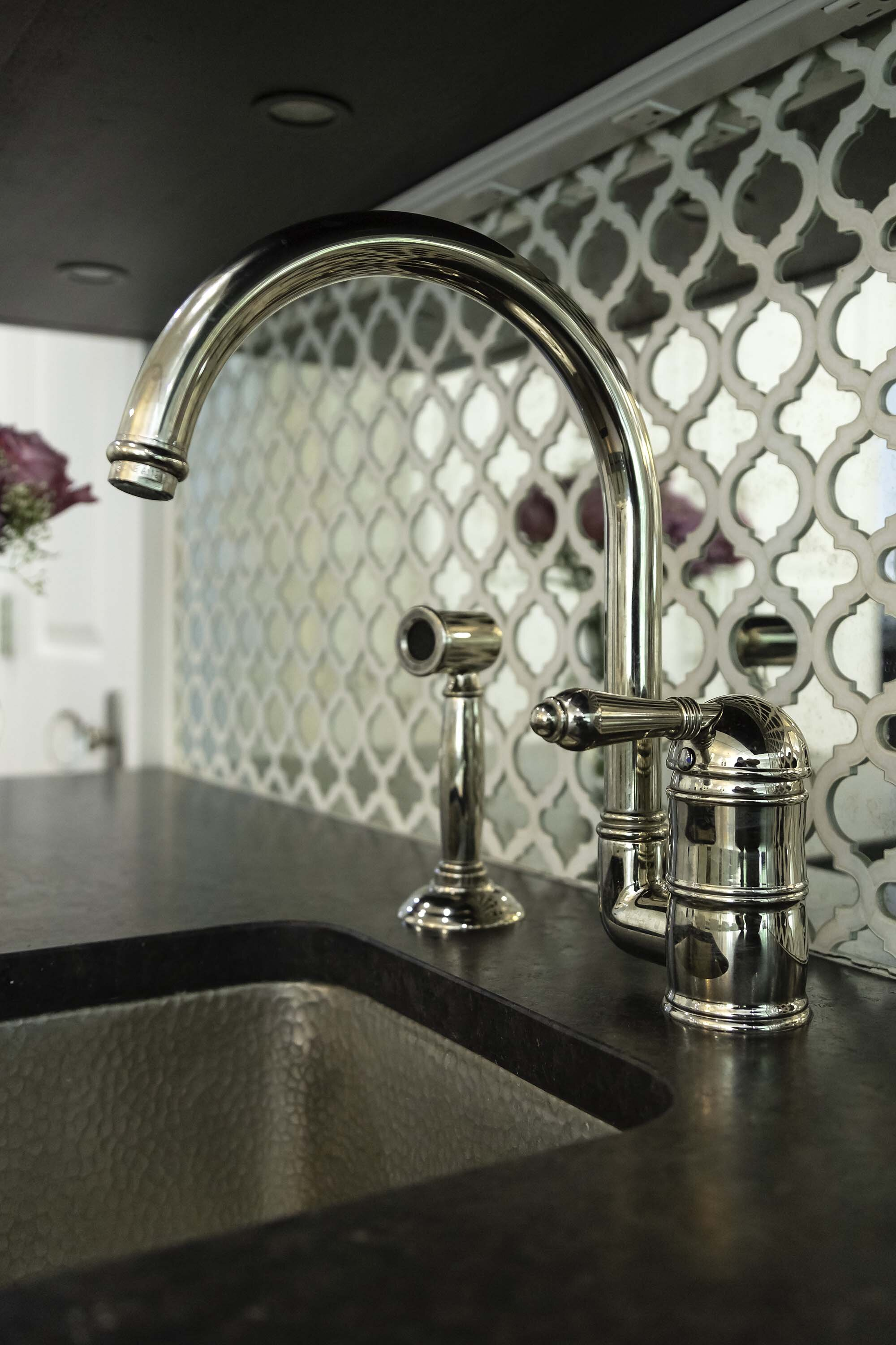 Traditional white kitchen on Long Island.  Detail Kohler faucet with mirror tile and hammered prep sink