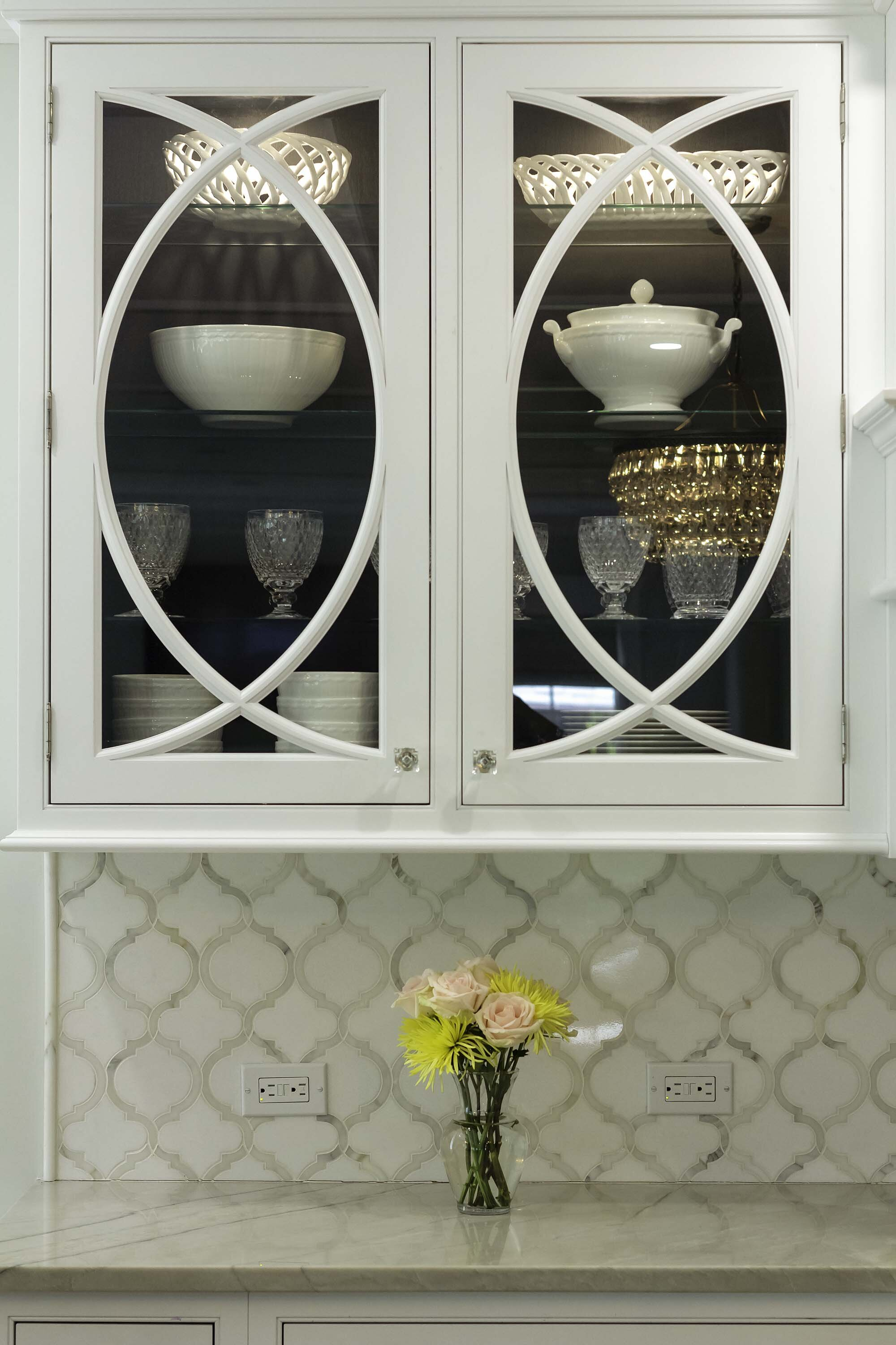 Traditional white kitchen on Long Island with curved mullion cabinet detail