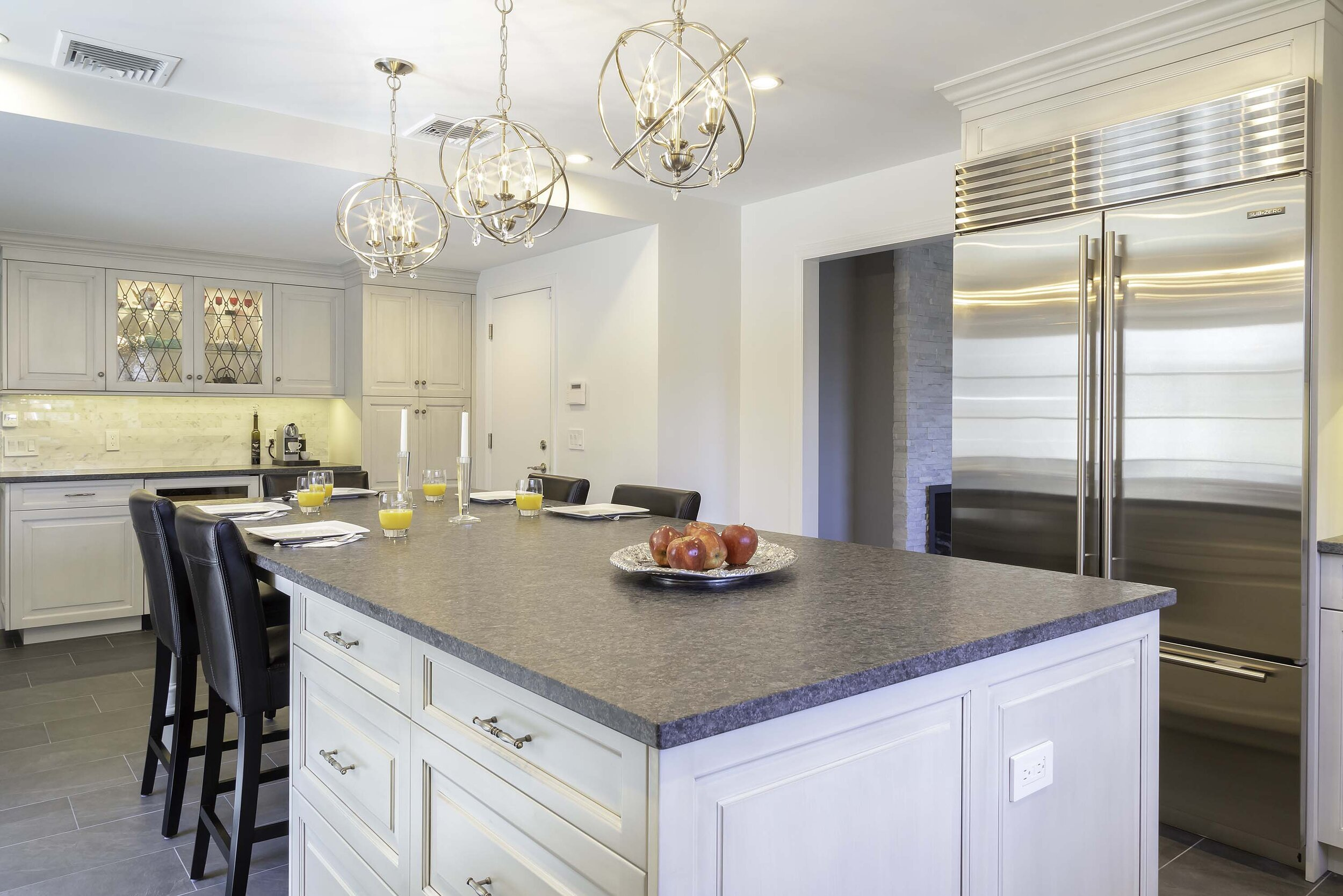 Long Island kitchen with extra-large Sub-Zero refrigerator freezer and granite countertop