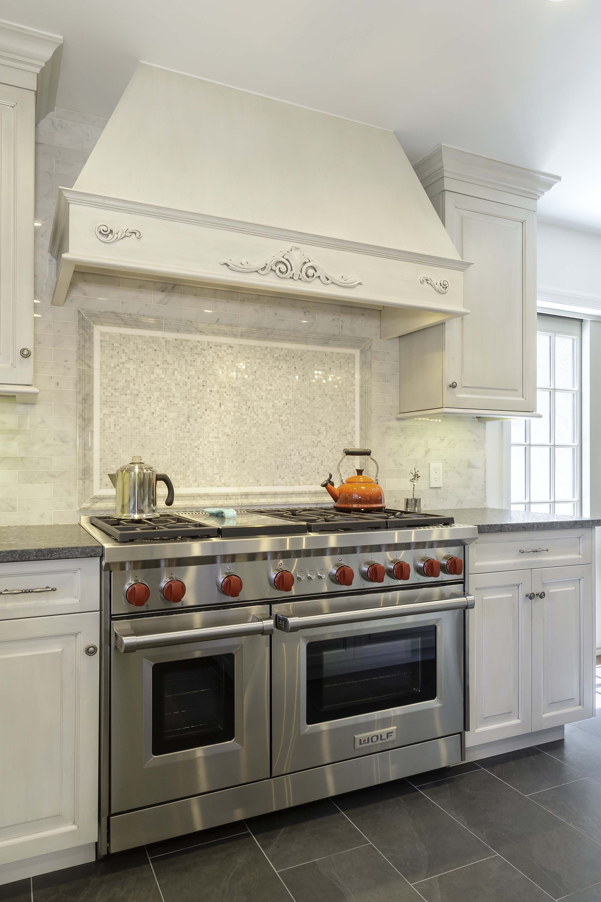 Long Island kitchen with double Wolf range and custom range hood
