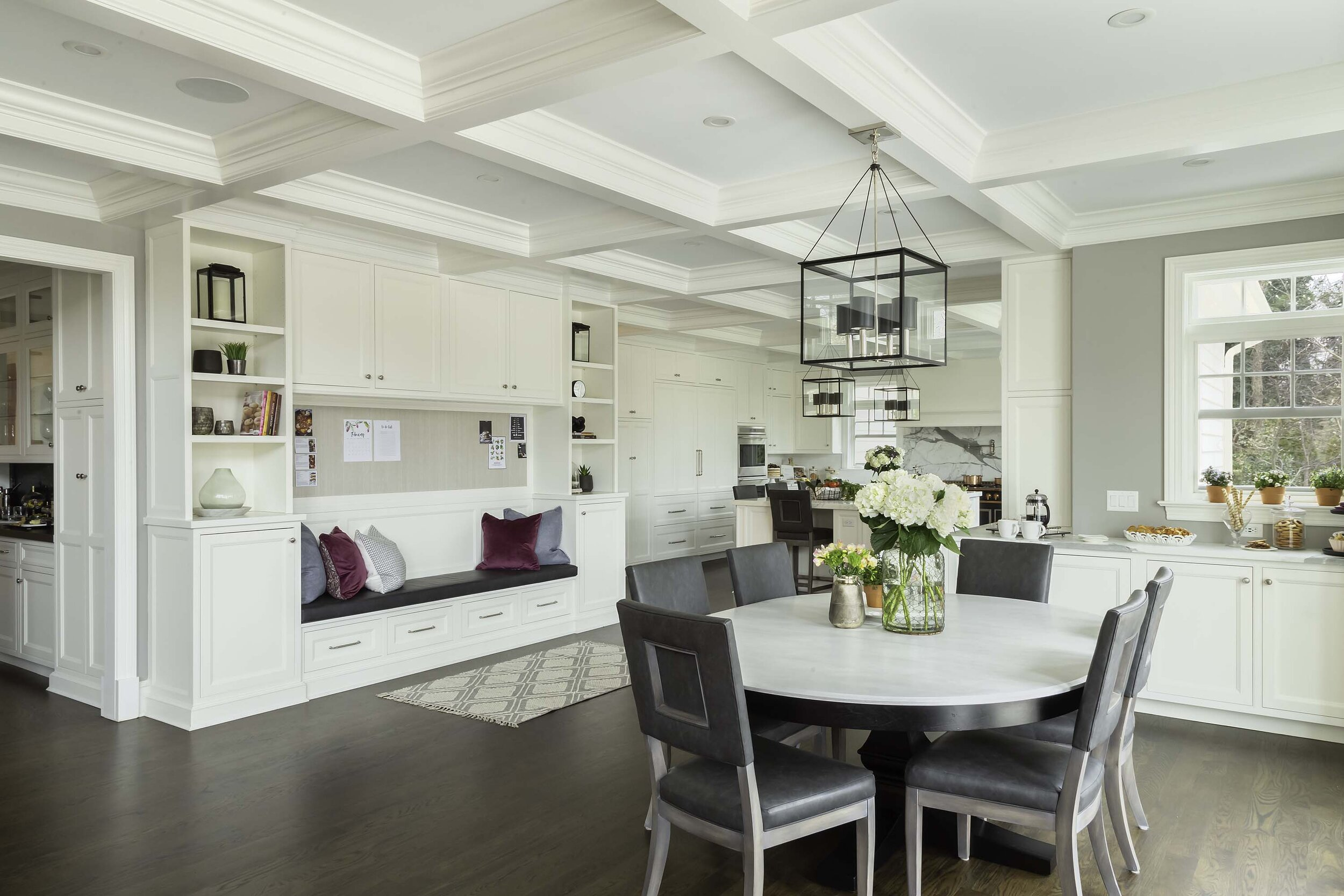 Transitional white kitchen with breakfast area and banquette storage