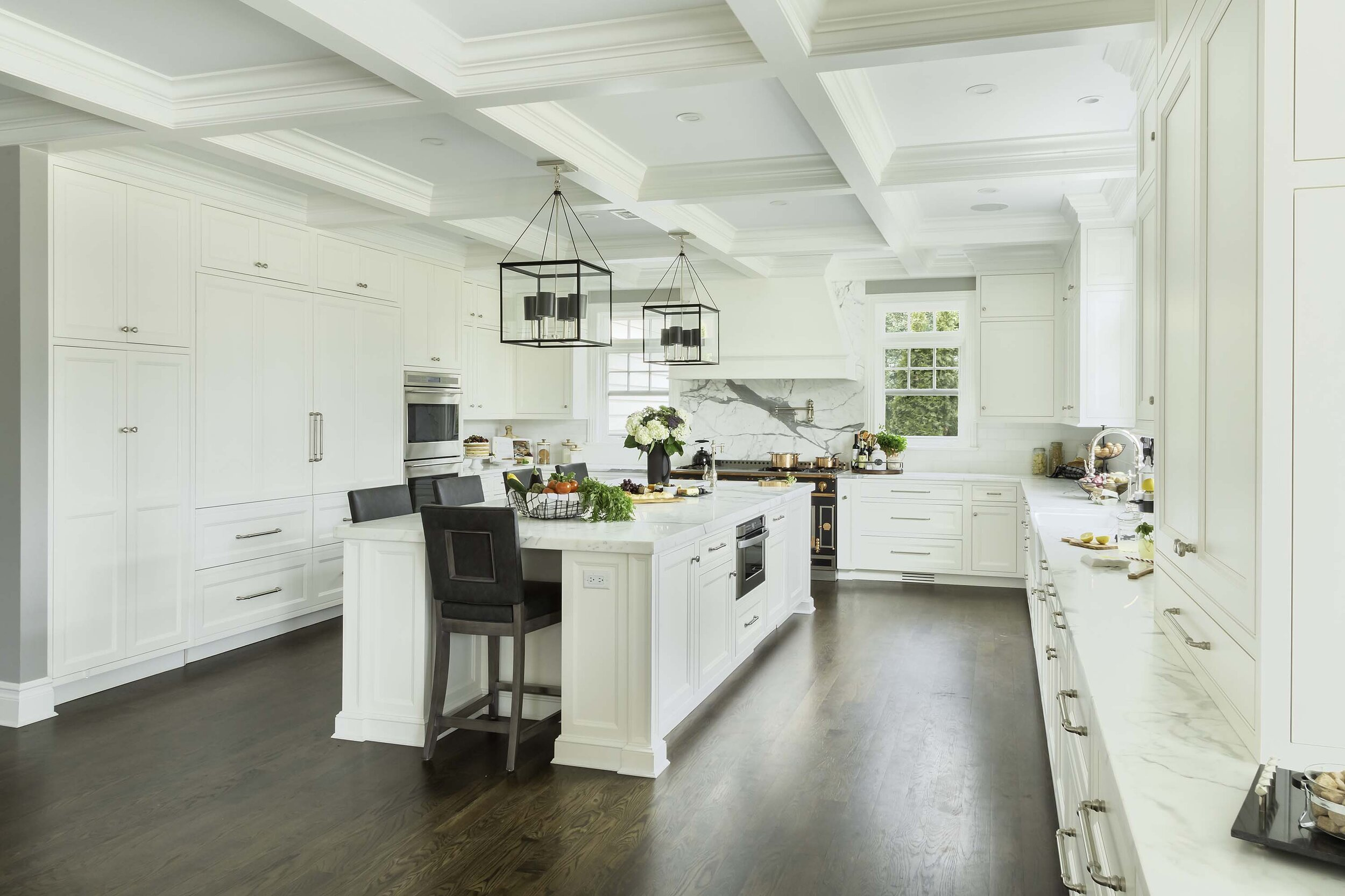 Transitional white kitchen with double Sub Zero refrigerator