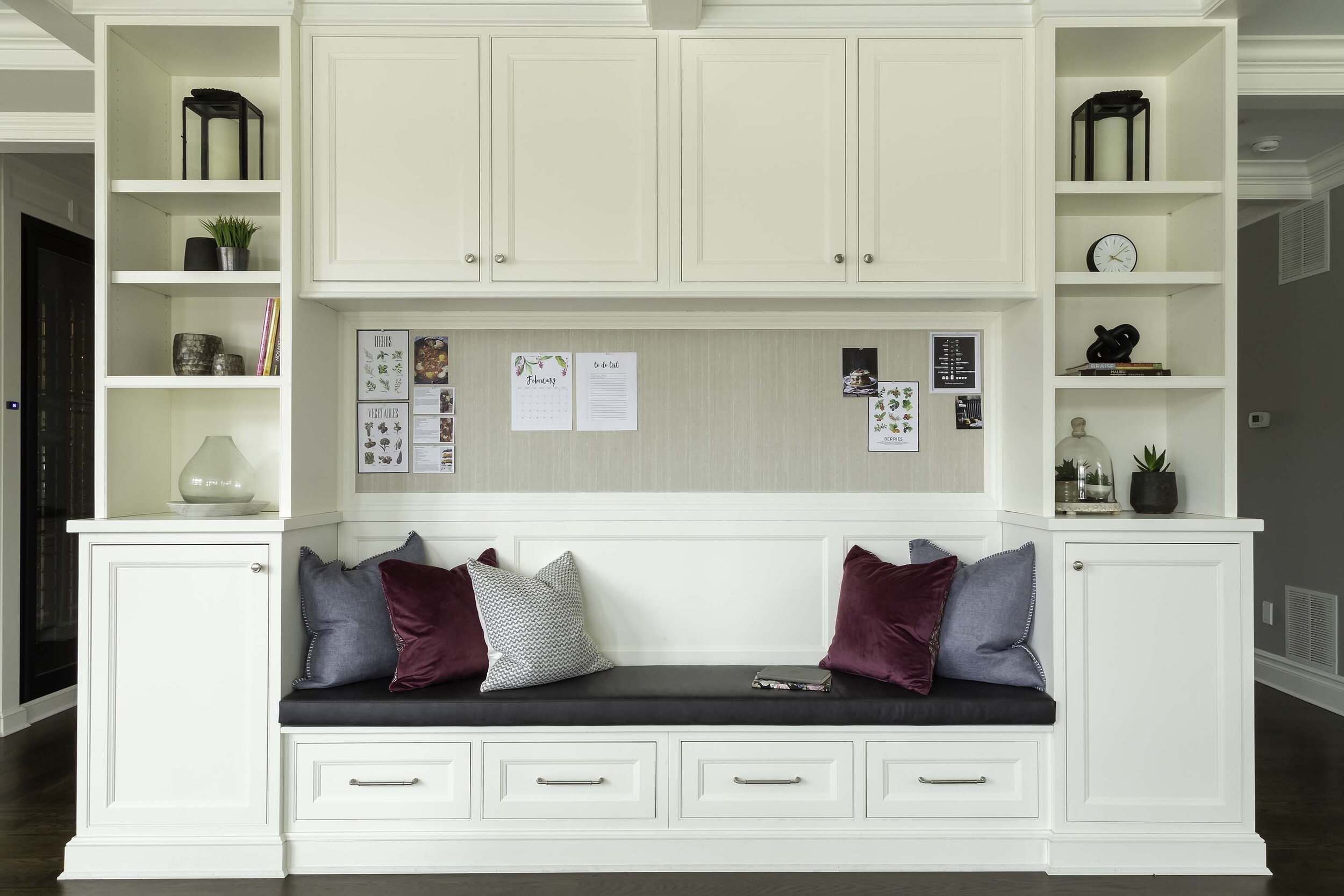 Transitional white kitchen with built in storage banquette