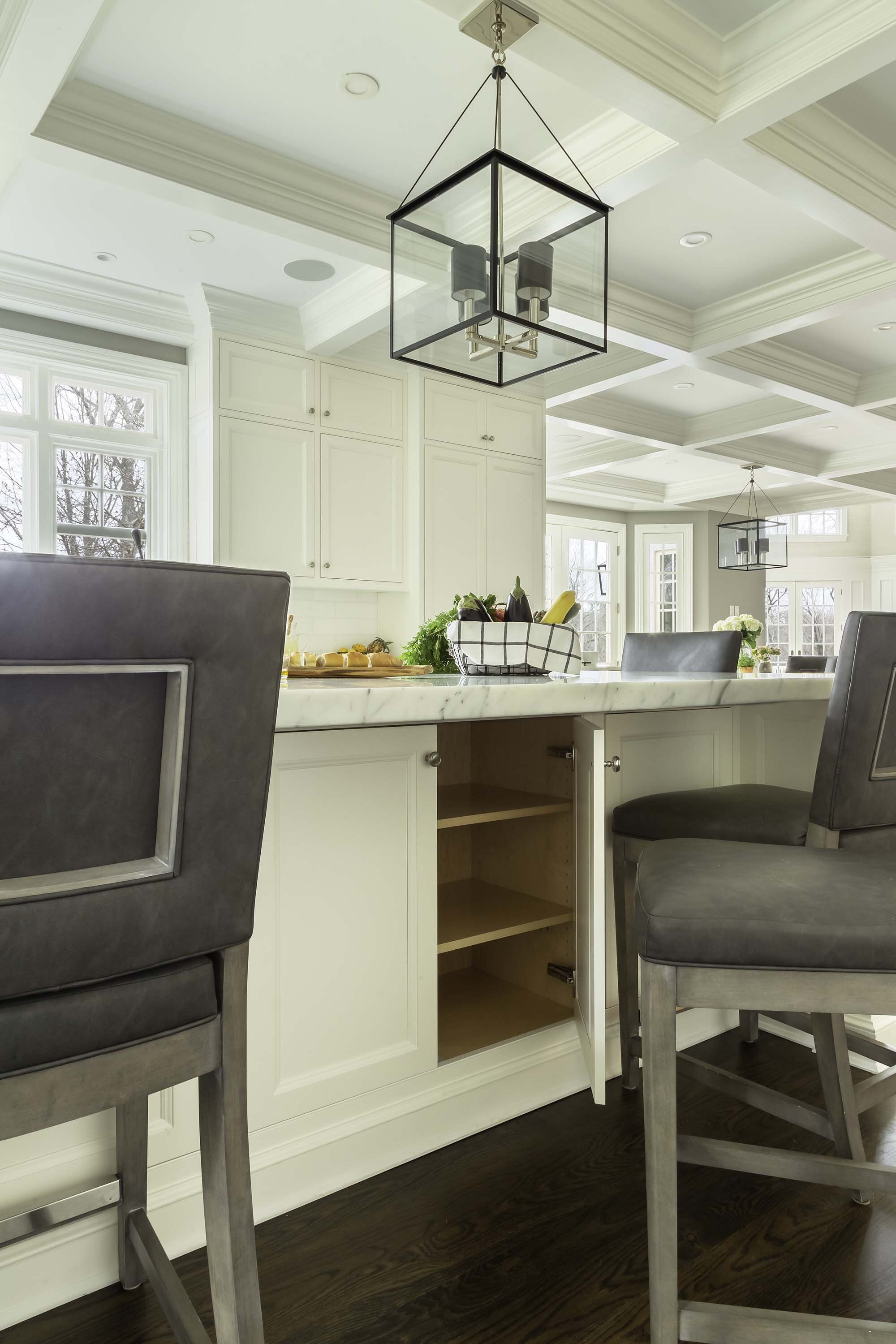 Transitional white kitchen with La Cornue range and statuary marble backsplash