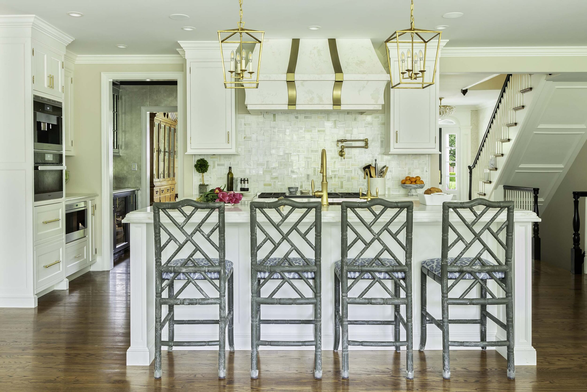 brass inserts and accessories add accents in this transitional white kitchen