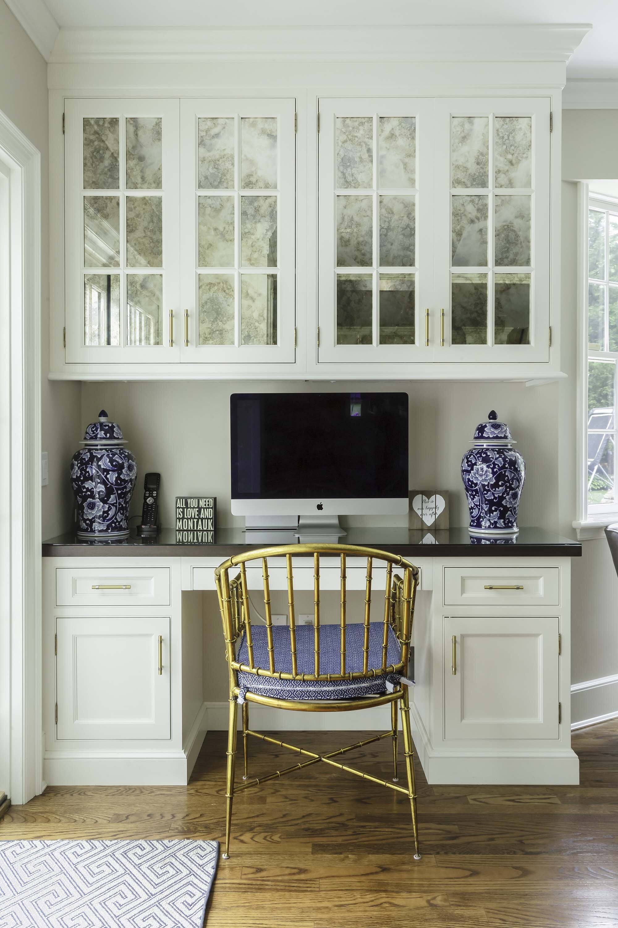 Custom desk is part of this transitional white kitchen