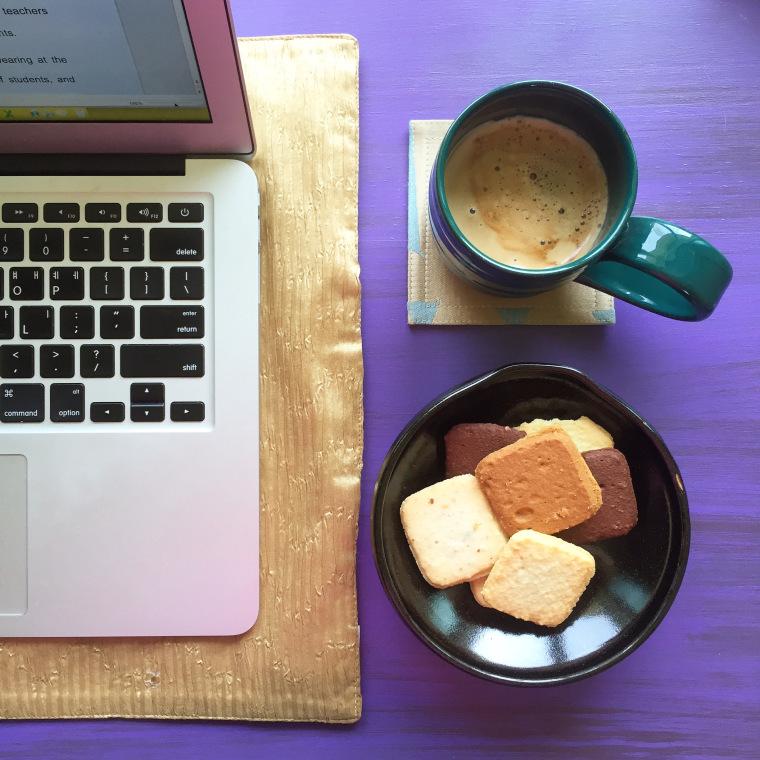 Apple computer coffee and cookies purple background Josette LeBlanc