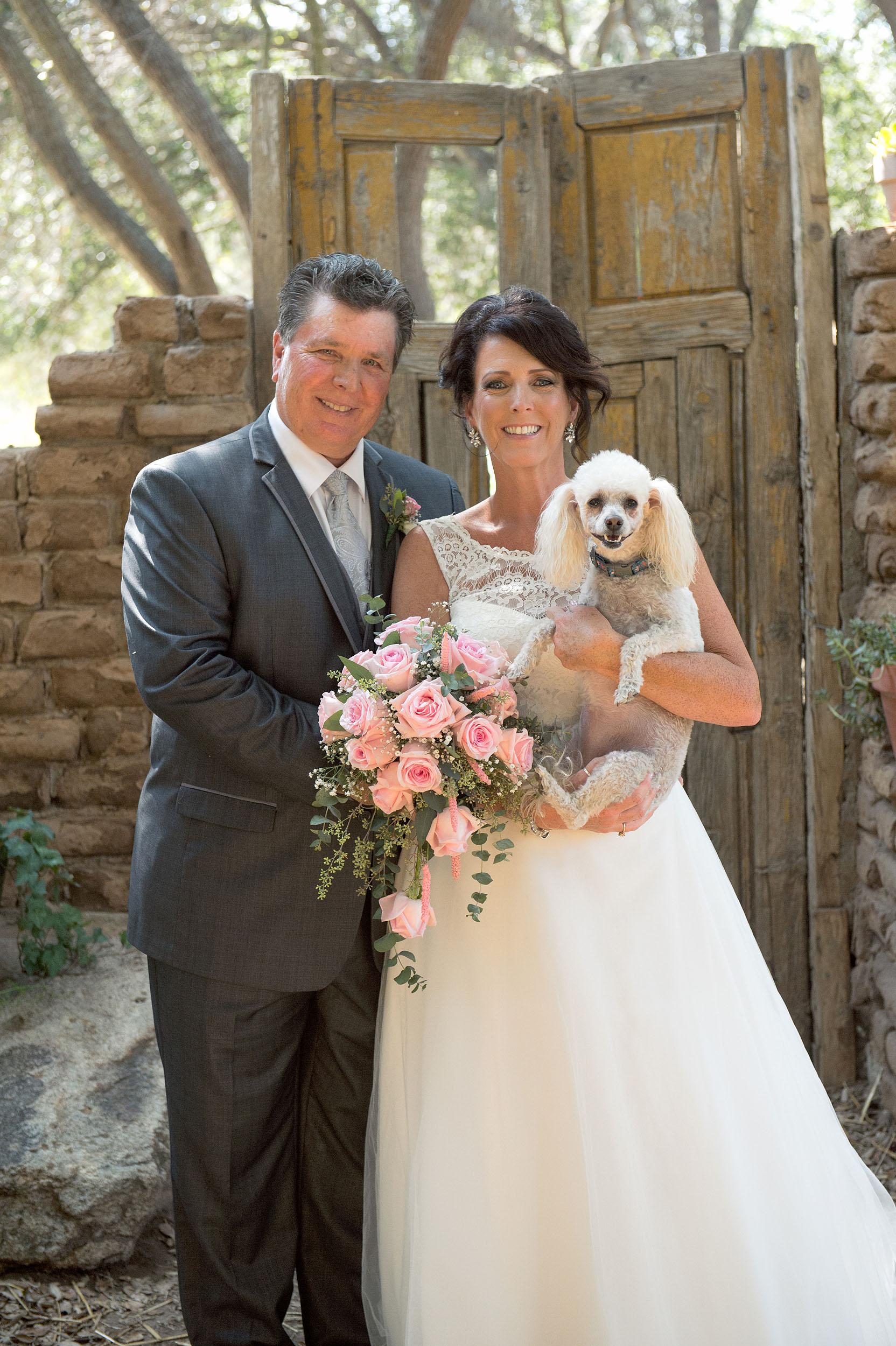 Bride, groom and pet dog portrait at Myrtle Creek Botanical Gardens & Nursery in Fallbrook.