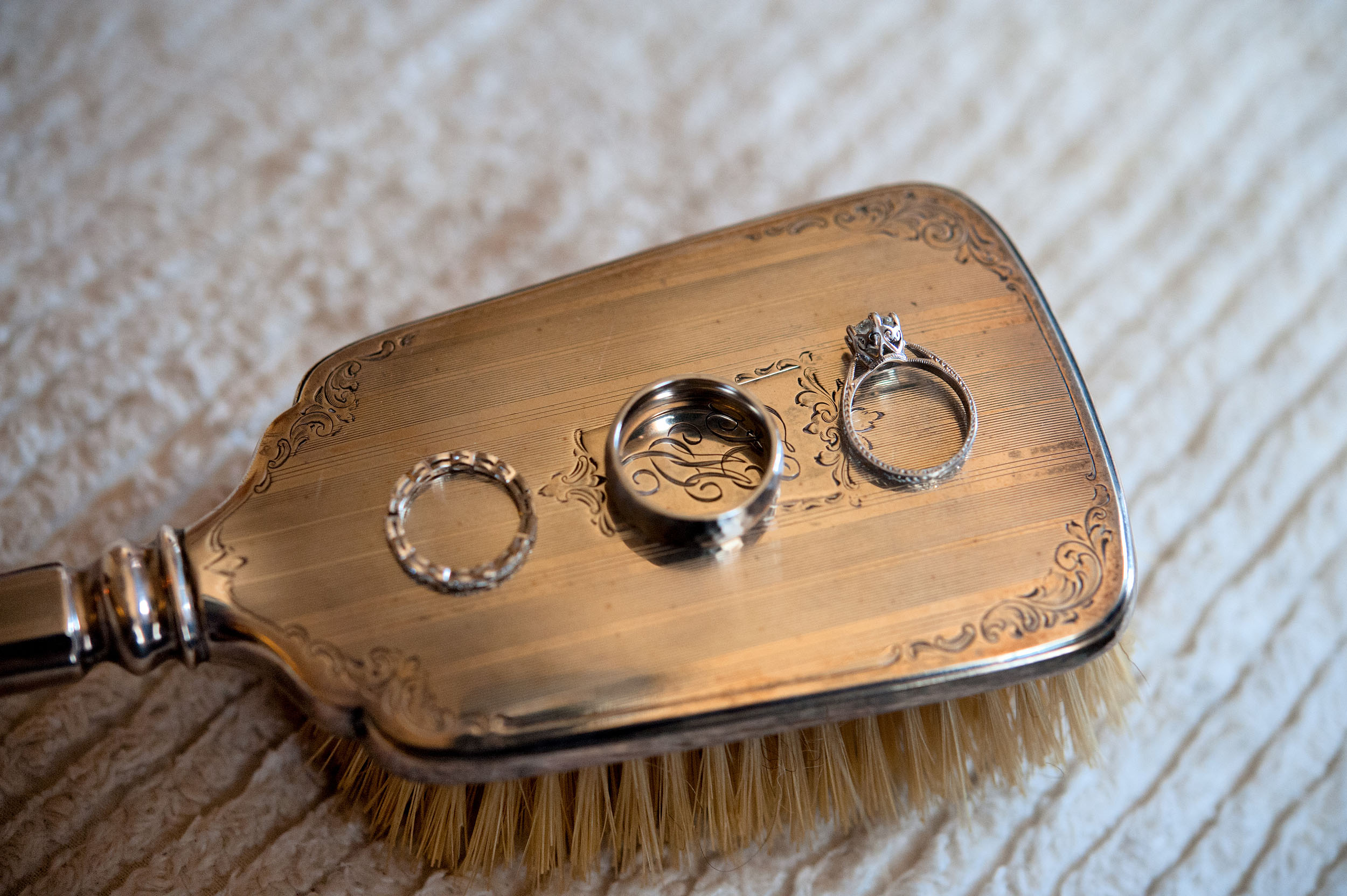 Bride's and Groom's rings on a silver hairbrush at the Oviatt Penthouse in Downtown Los Angeles.