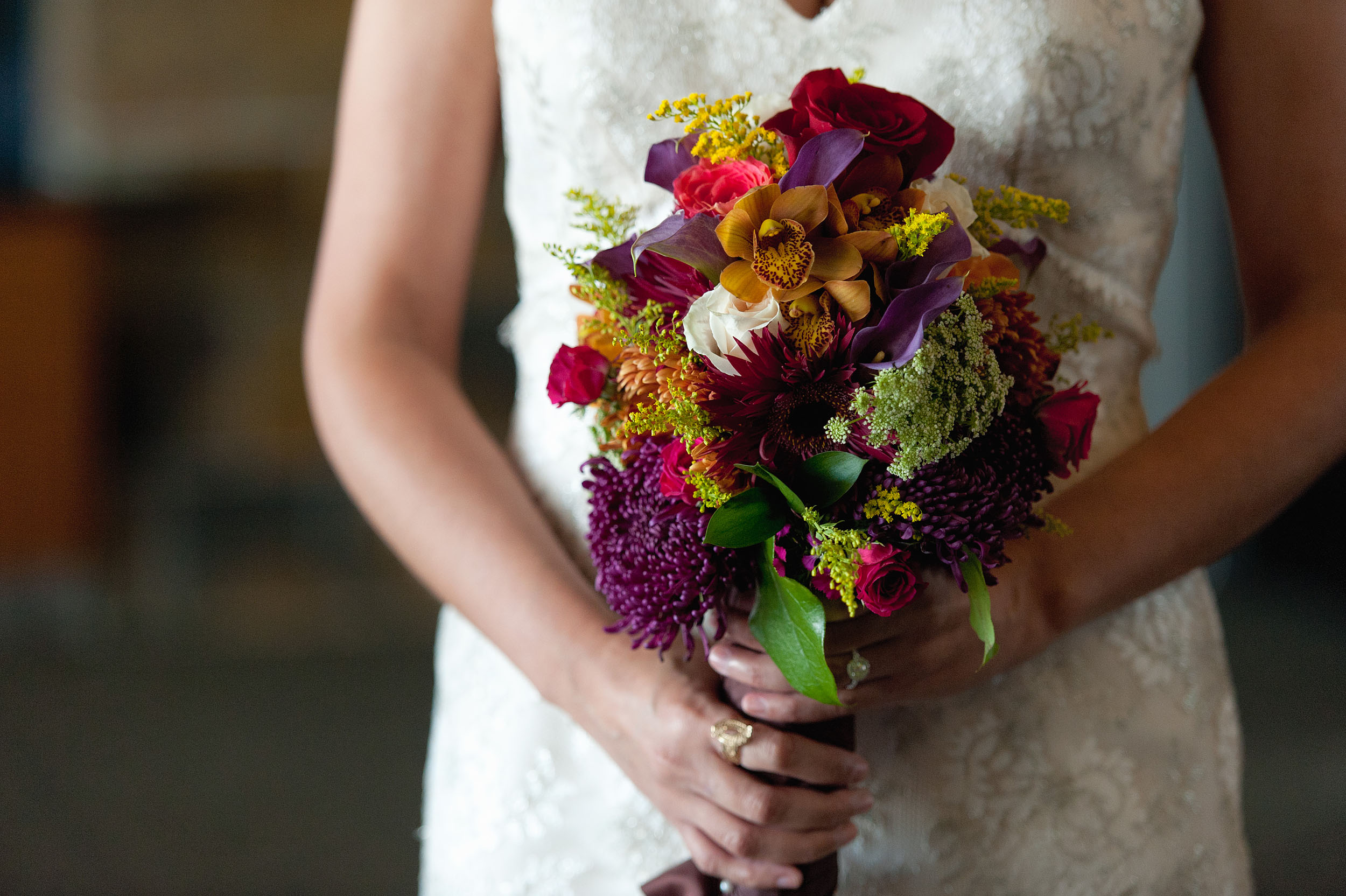 Detail of bride holding bouquet at Harvest Christian Fellowship in Riverside.