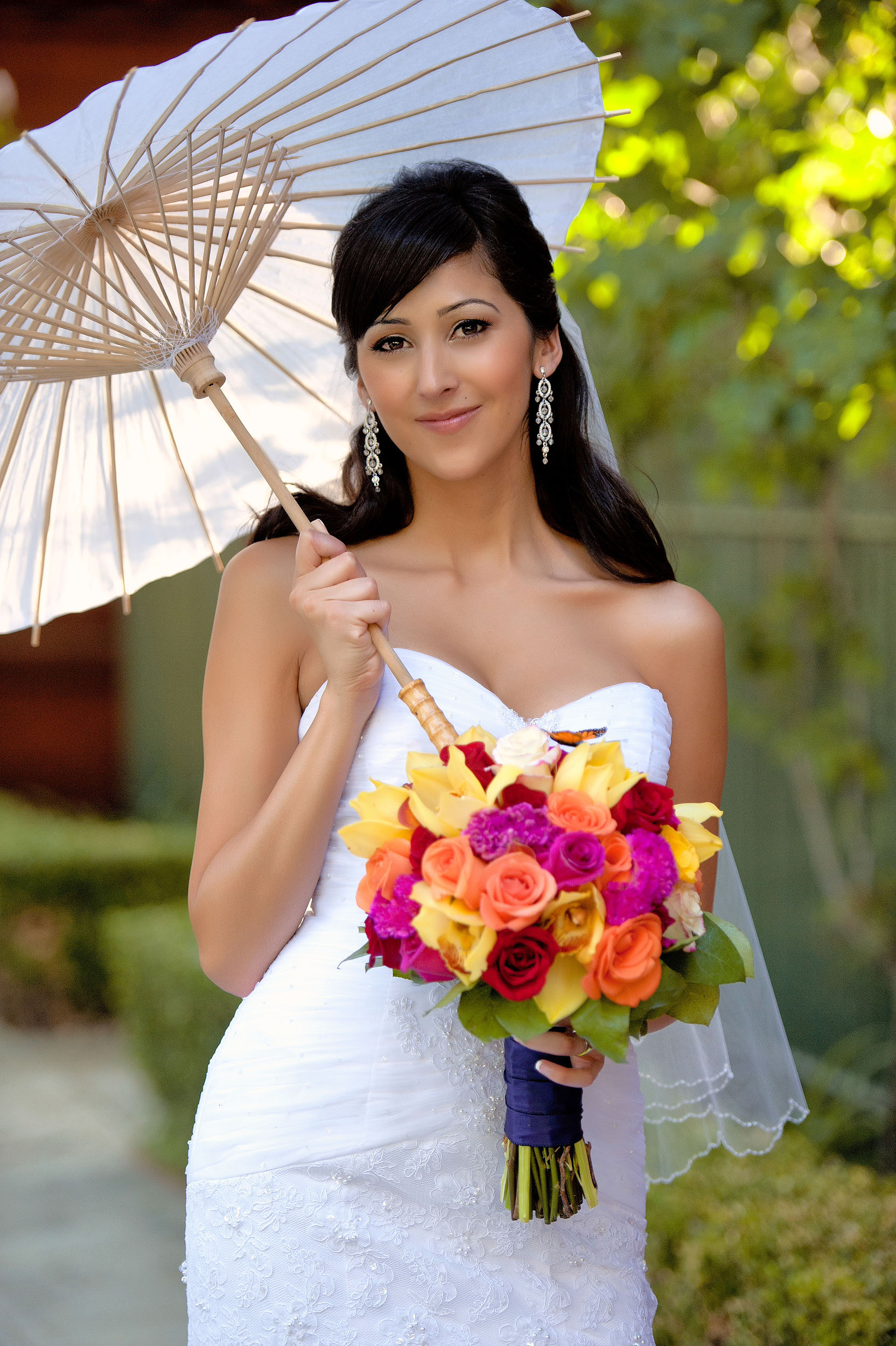 Bride with bouquet and parasol at A.K. Smiley Public Library in Redlands.