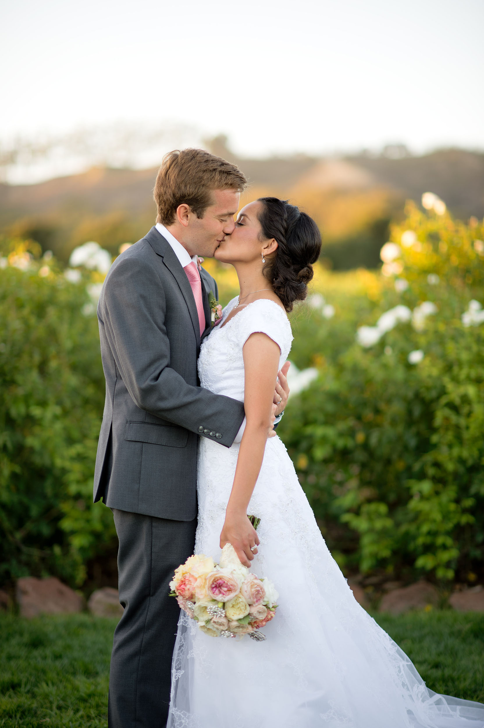 Bride and groom kissing at Gerry Ranch in Camarillo.